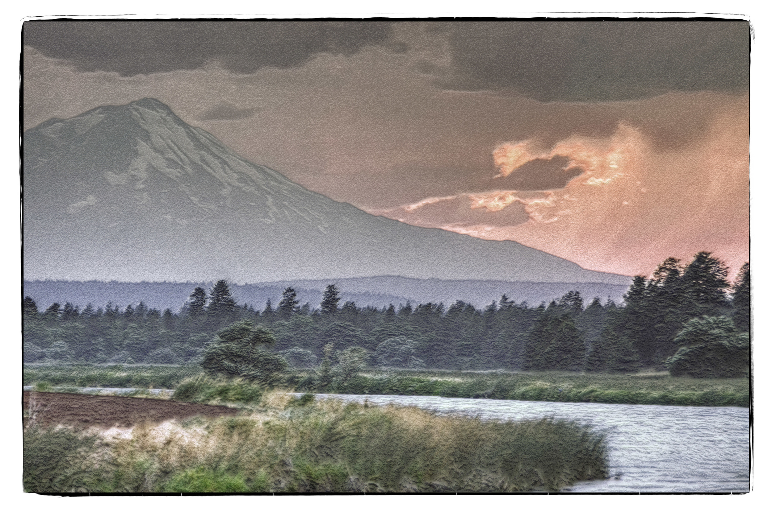 The sunset peeks from behind Mt. Shasta and from under the clouds.