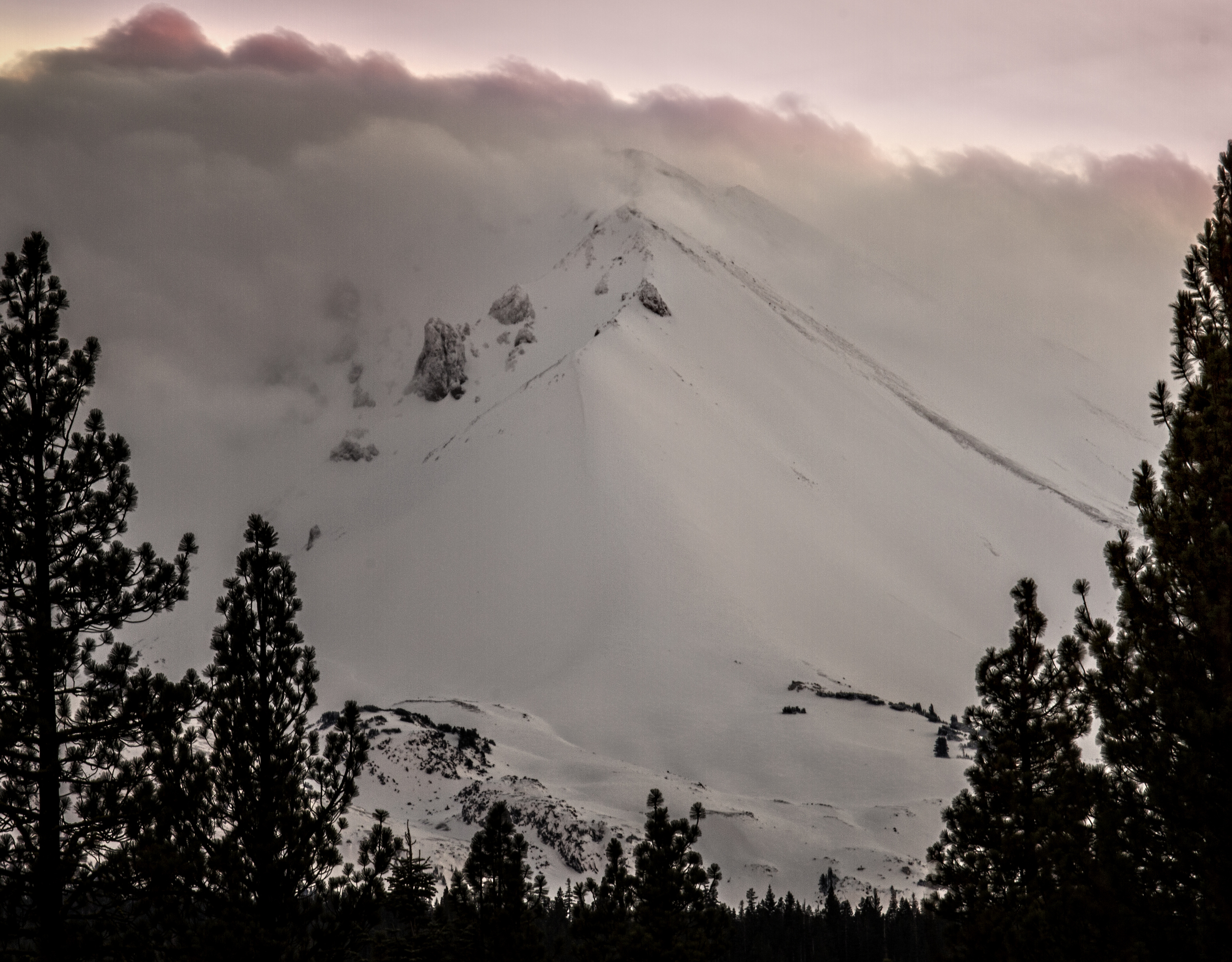 Mt. Lassen emerges from a clearing storm at sunset.