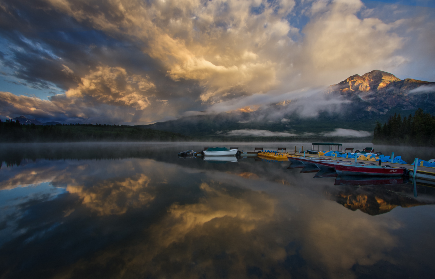 Canadian Rockies' Sunrise at Pyramid Lake  More textures, more beautiful light on magnificent clouds reflected in calm water with spots of bright colors on the boats. This one was an easy pick.