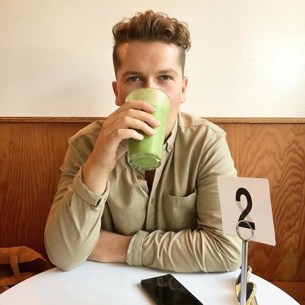 Matt drinking a green smoothie at Honey Hi