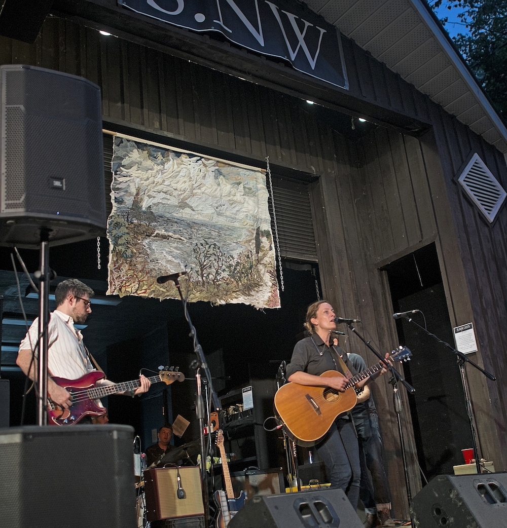 """Photo of  musical talents with Canadian icon/headliner,   Sarah Harmer   and up cycled textile art by Mihal Zada   Art on stage: Secret Beach, Prince Edward County   at Sandbanks New Waves Festival in Sandbanks Provincial Park    Sarah Harmer played her newest song -  """"Just Get Here""""  from the  """"Al Purdy Was Here""""  documentary soundtrack    19 September 2015"""