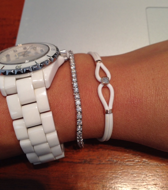 """""""Layering"""" diamond tennis bracelet with other accessories"""