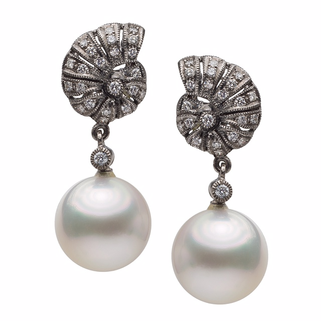 Pair of one of a kind Earrings with AAA quality South Sea pearls, 12 mm, diamonds set in black rhodium 18K gold earrings. Price : $ 1,950.00