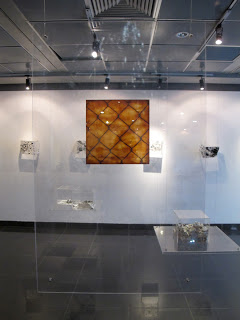 """Lacquer """"skin"""" mounted between two sheets of lucite"""