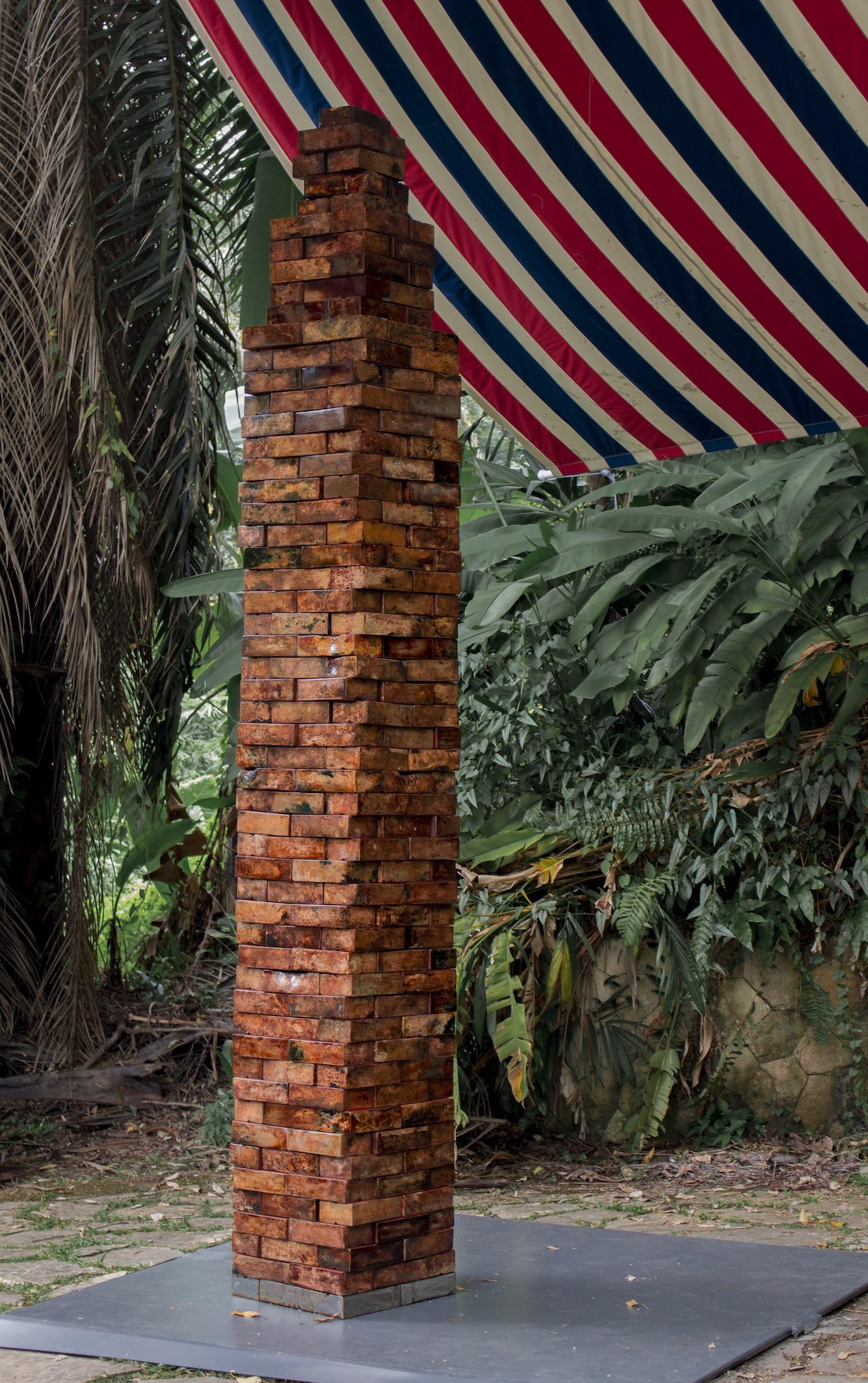 Obelus, 2016. Vietnamese Son Ta Lacquer on 315 individual iron bricks. Photo by Josephine Herbelin.