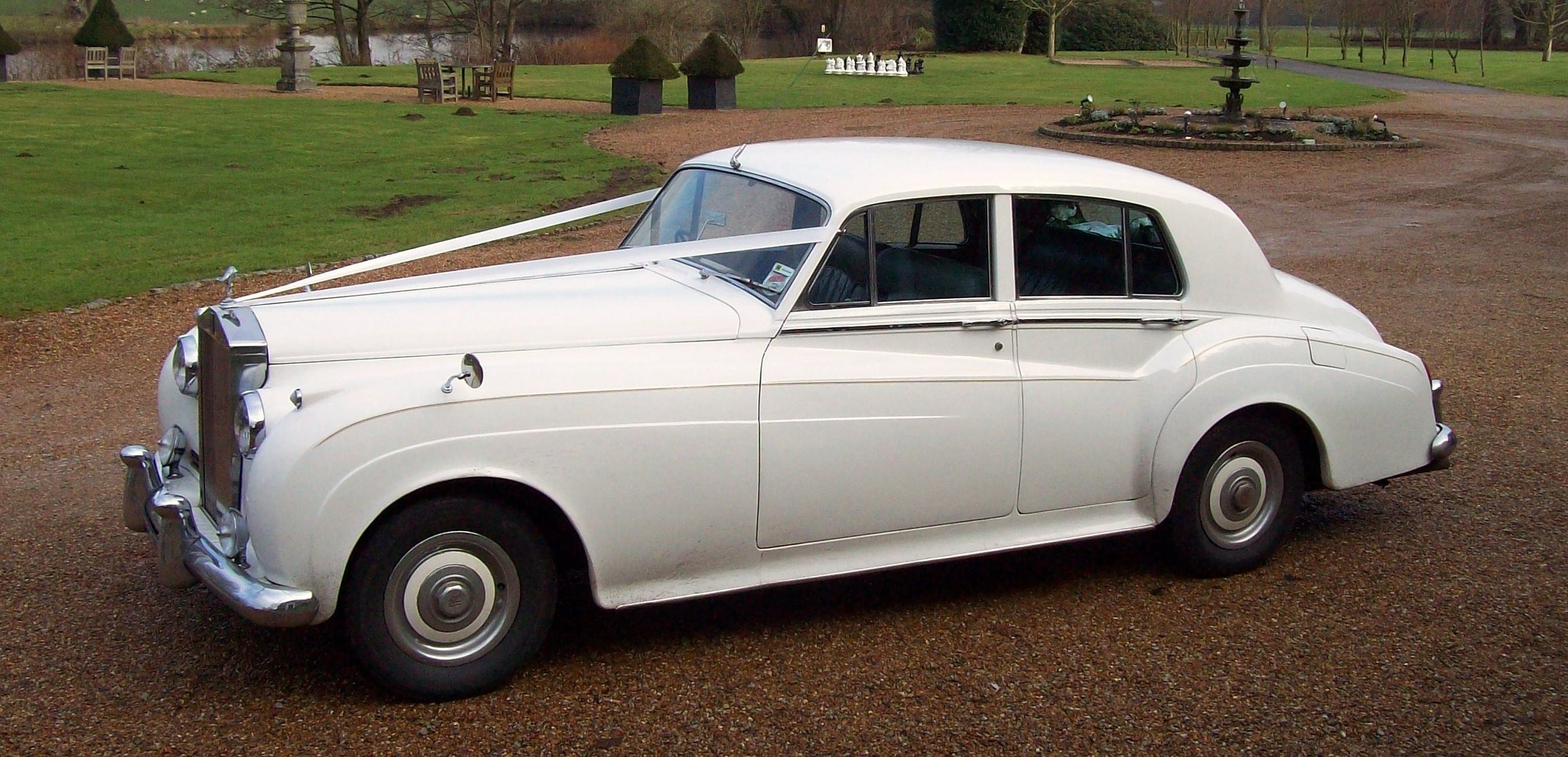 White Rolls Royce silver Cloud at Chilston Park wedding.
