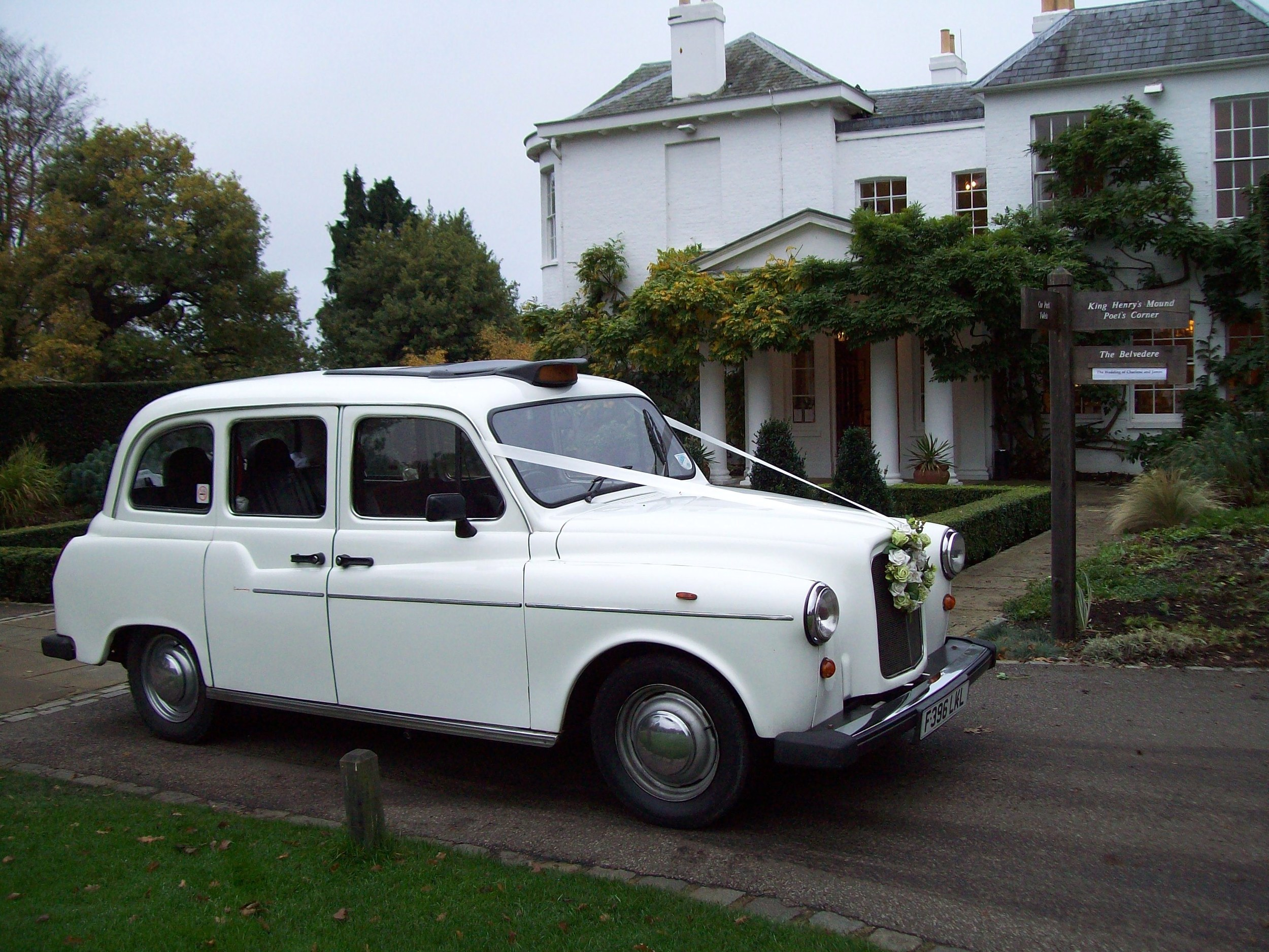 White Taxi Wedding Car