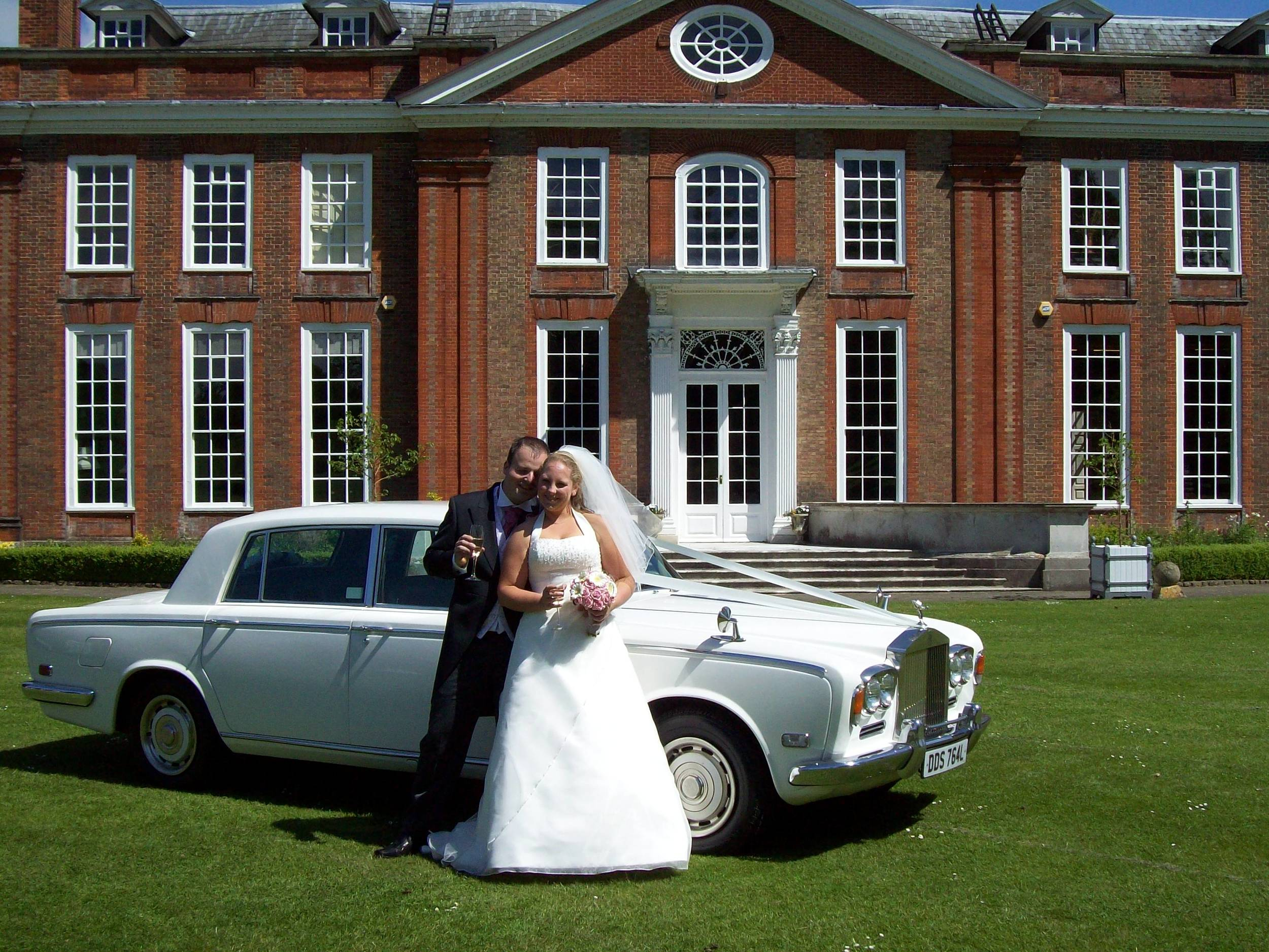 White Rolls Royce wedding car for Lauren & Joe's wedding at Bradbourne House in Maidstone.