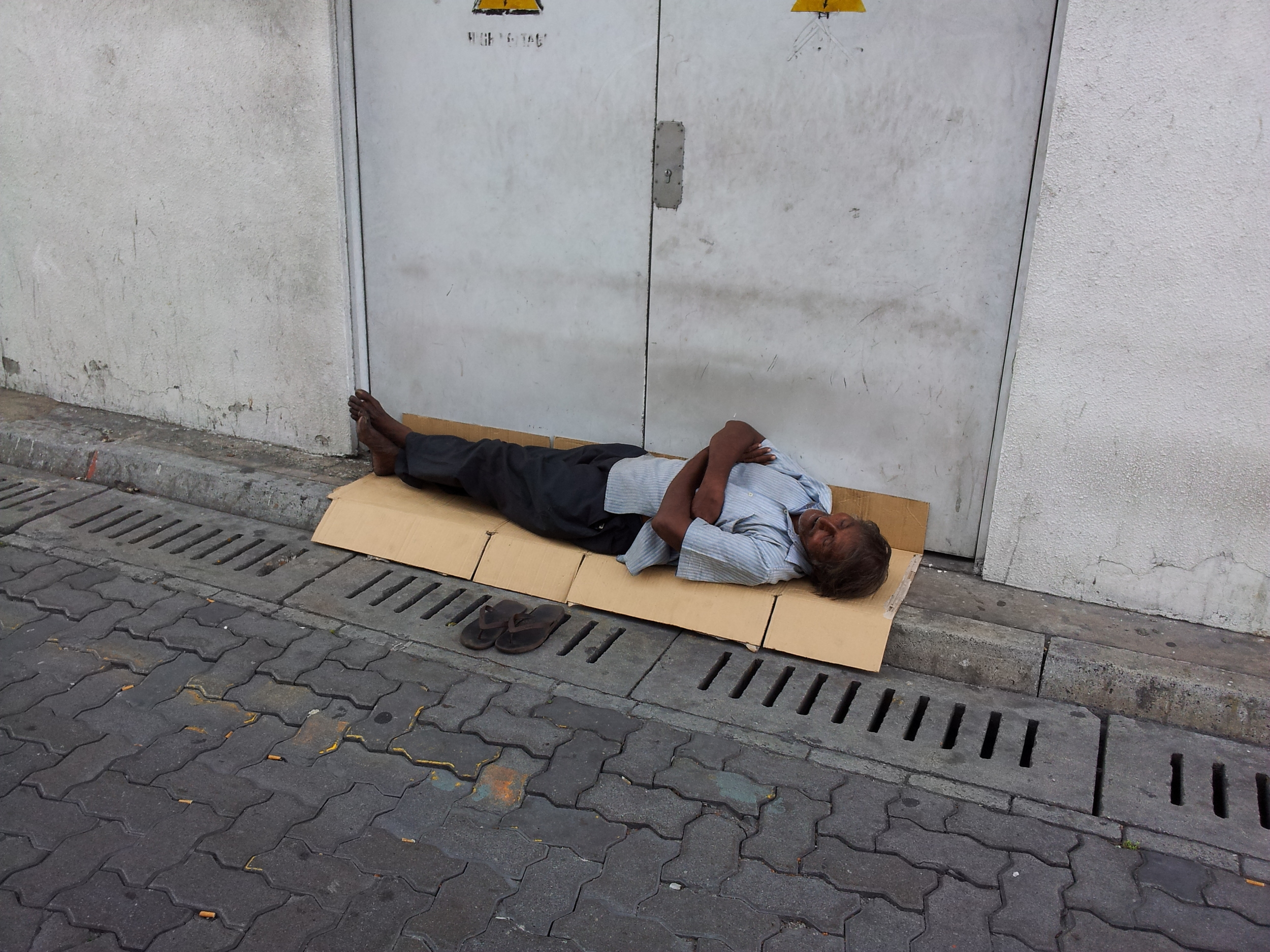 beggar on pavement Male.jpg