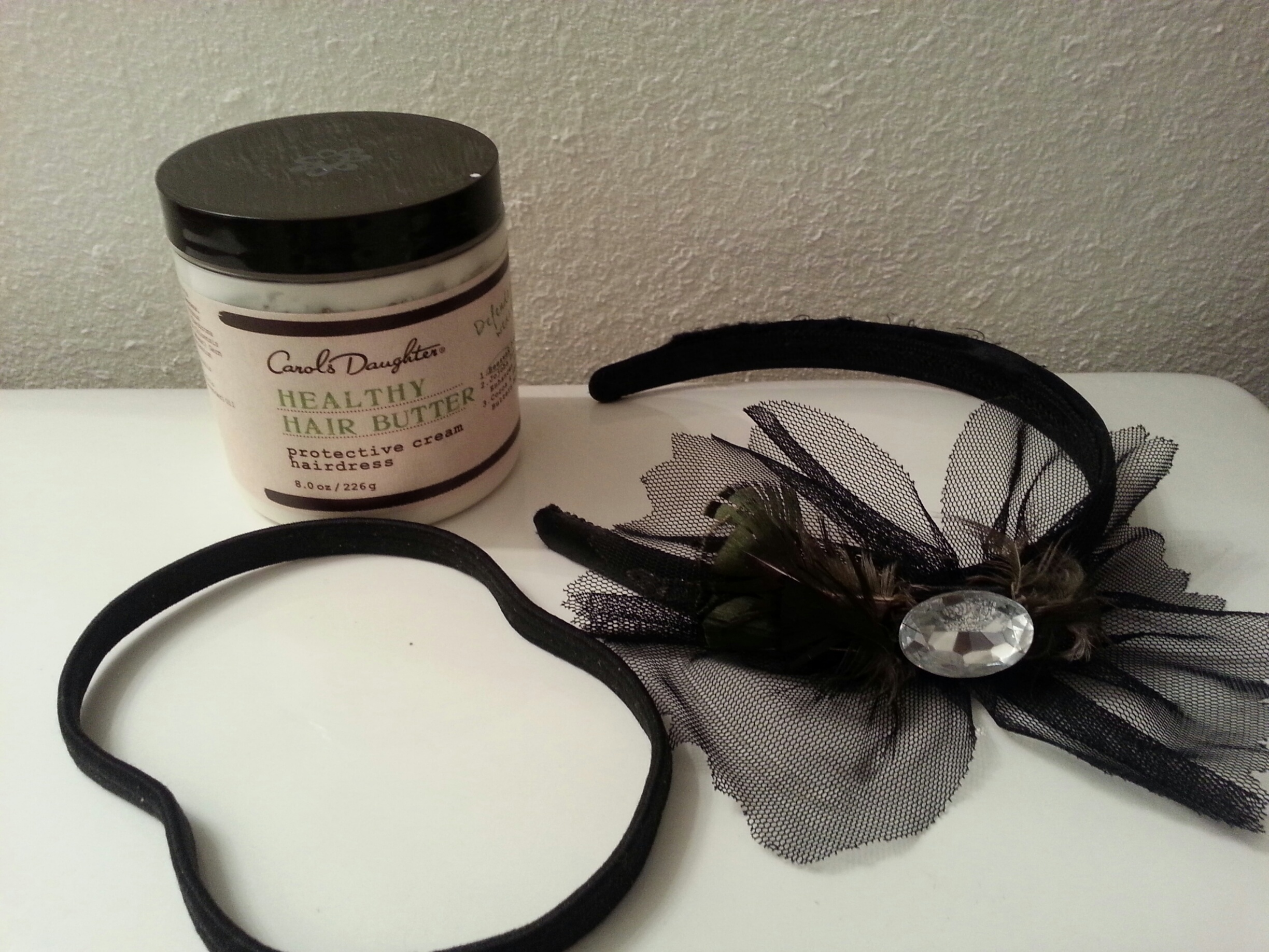"""Products Used: Carols Daughter """"Healthy Hair Butter"""", Elastic hair band and a cute head band (optional)"""