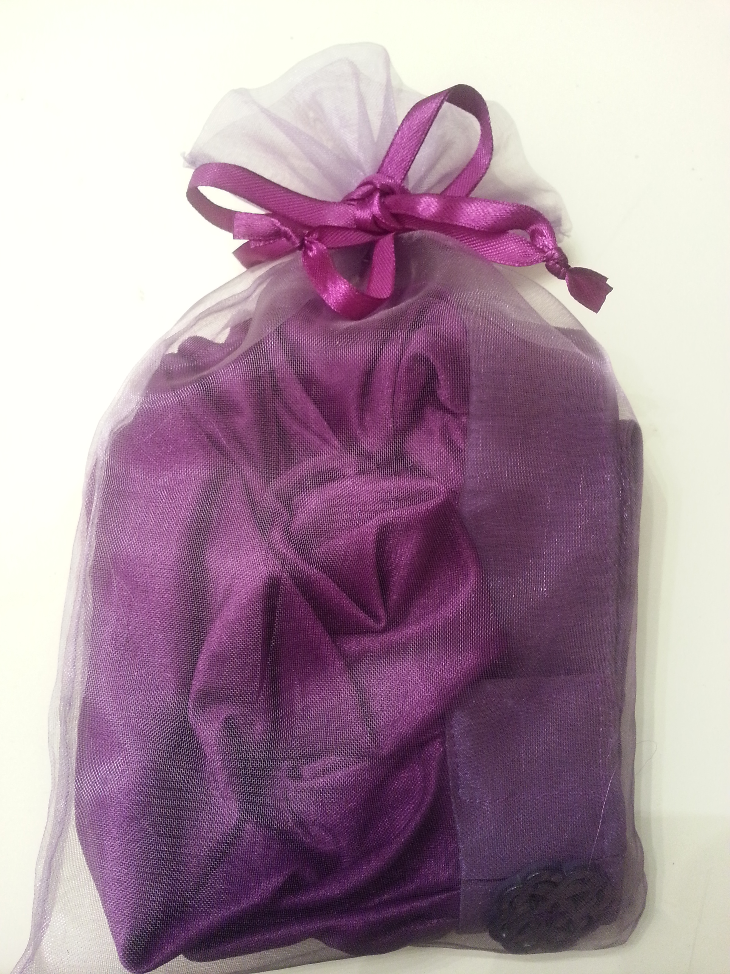 The wrap came in this pretty purple drawstring bag.