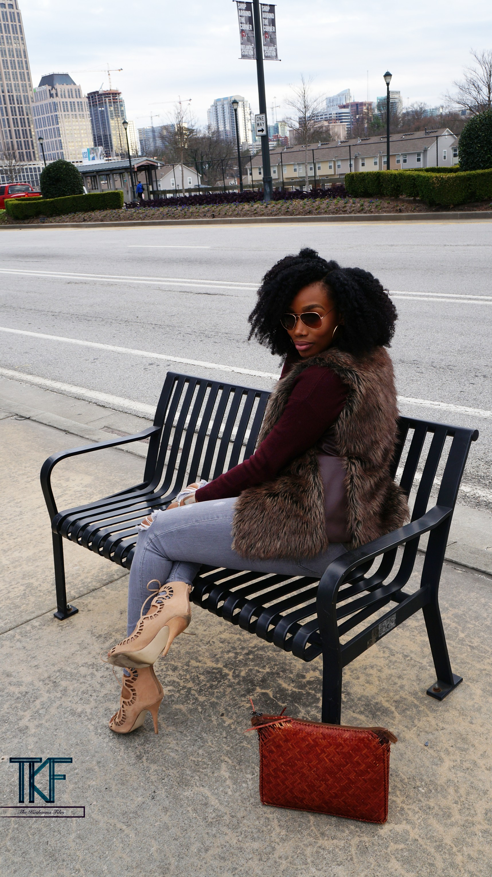 fashionable-girl-sitting-on-a-bench.jpg