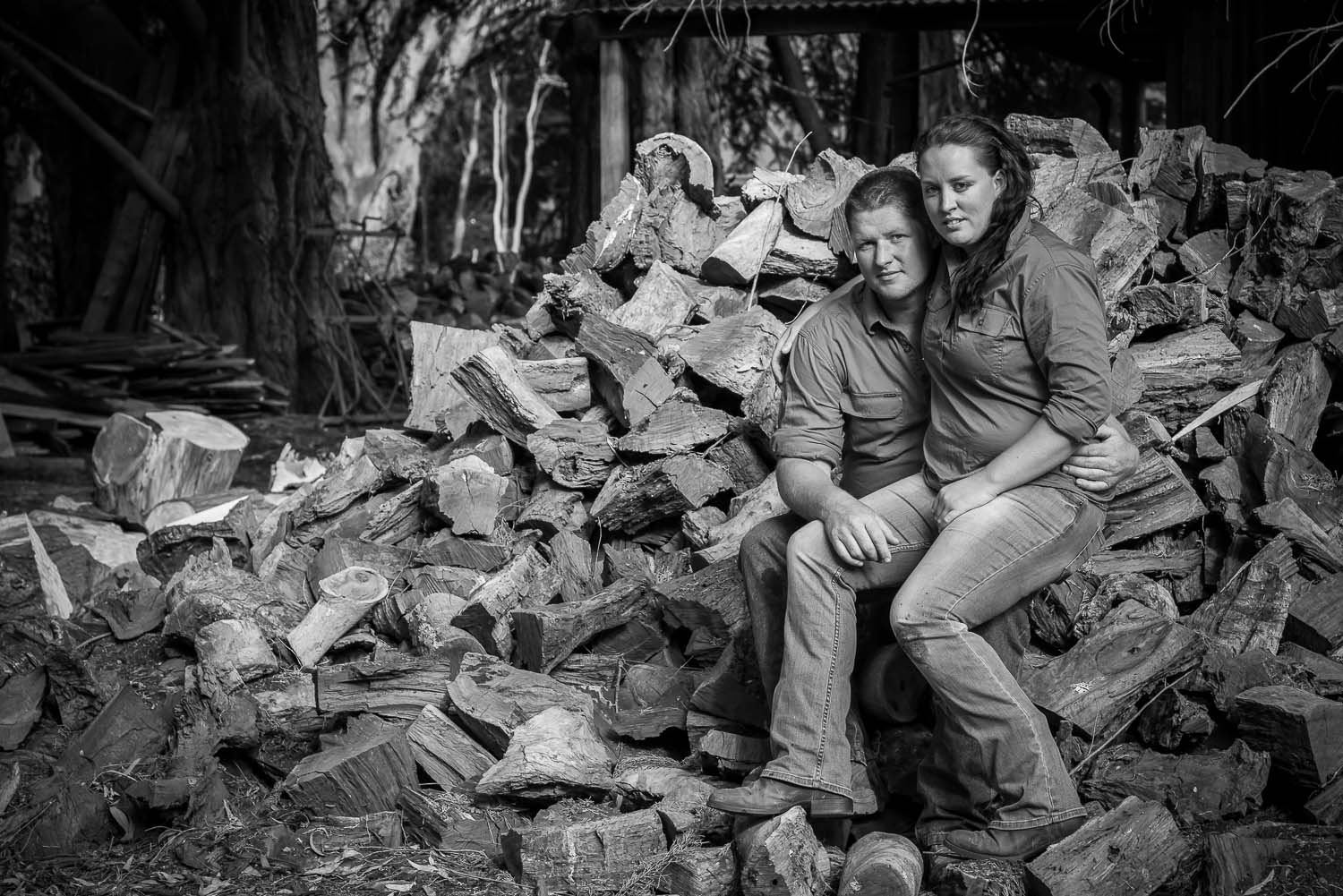 Couple pictured on wood pile