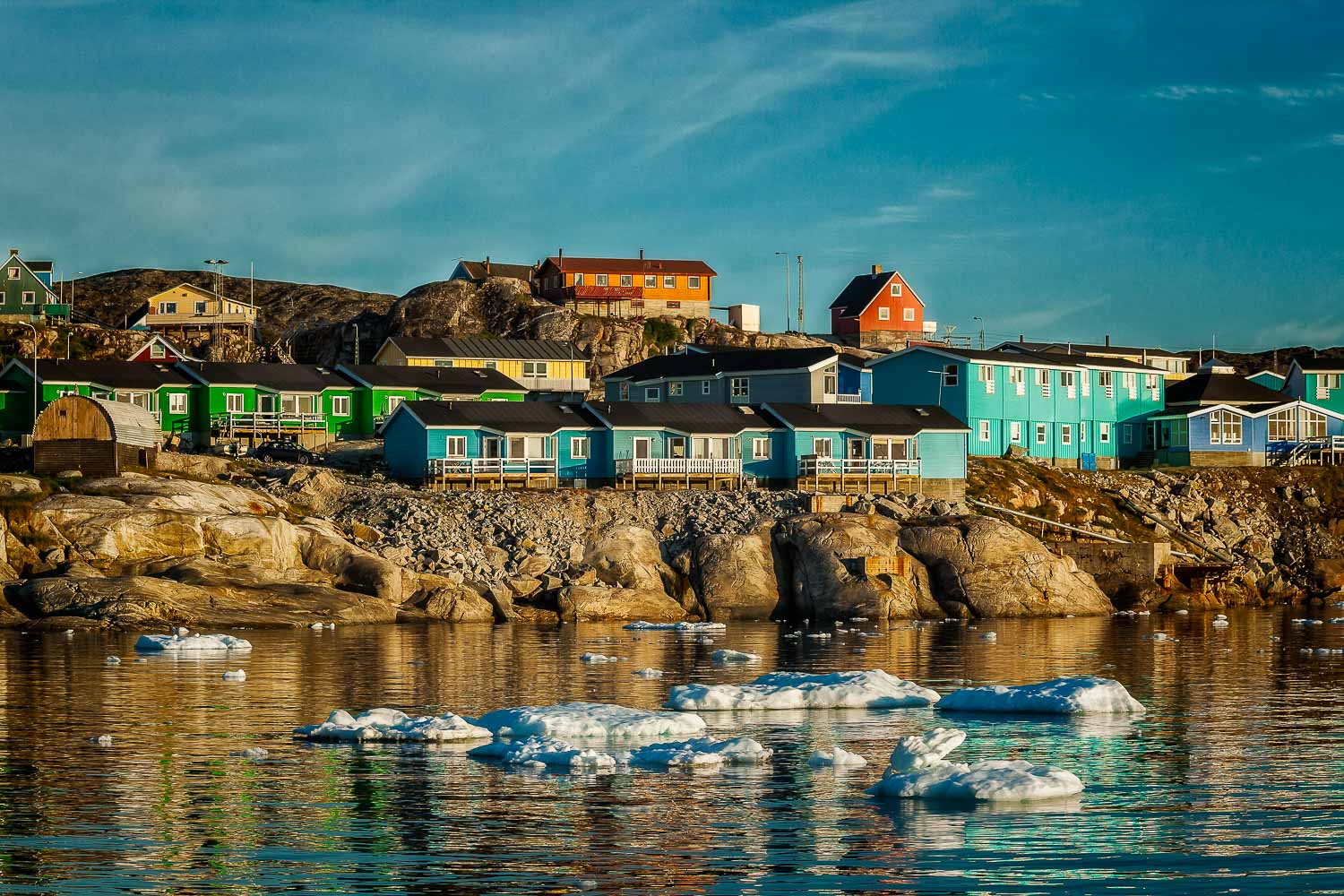 Colorful accommodation overlooking the waters of the Ilulissat Icefjord in Ilulissat, Greenland.
