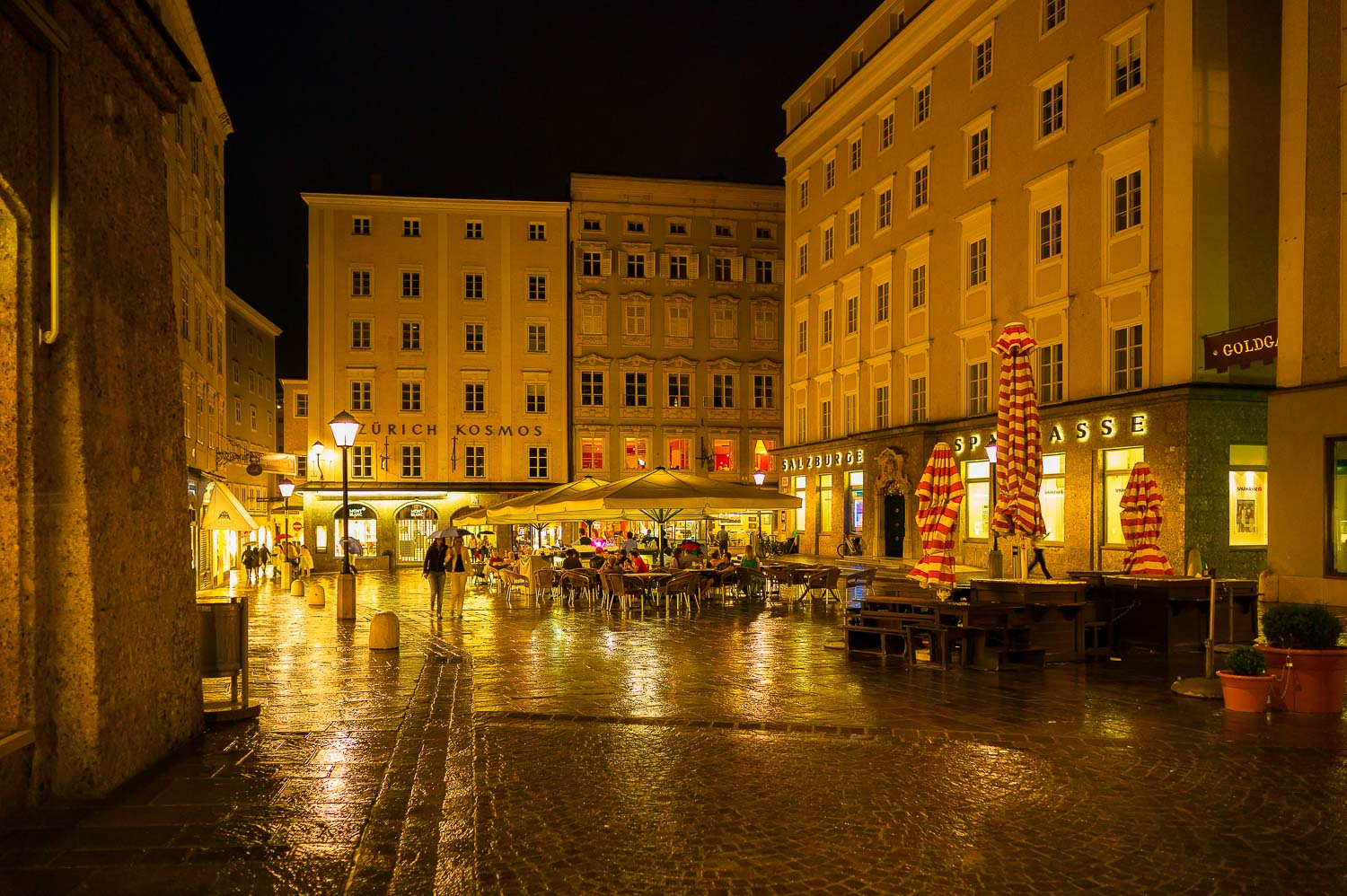 A rainy summer's night is no obstacle to dining outoors in the beautiful old town of Salzburg, Austria.