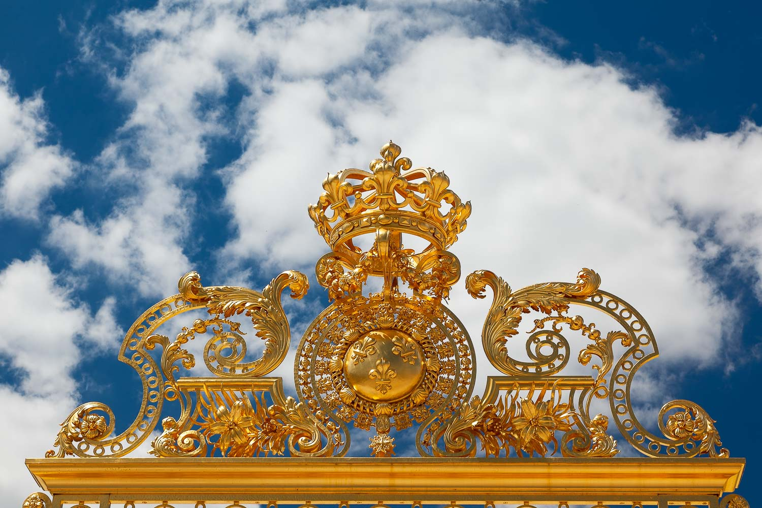 A detail of the top of the entrance gate at the glorious Palace of Versailles, France