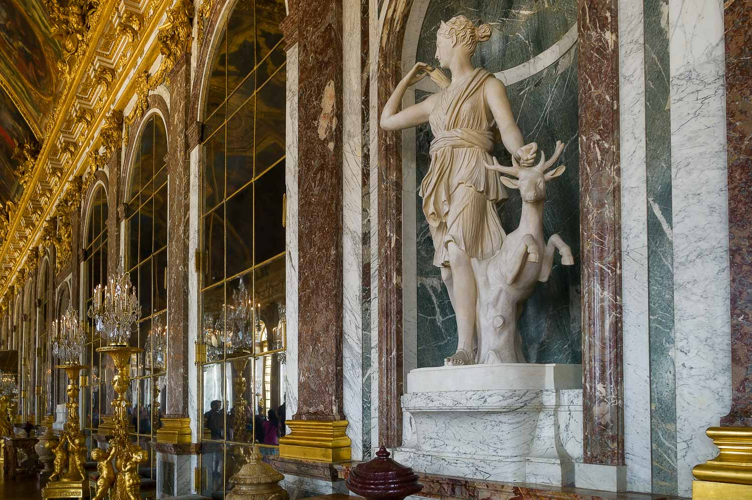 A statue in one of the magnificent rooms at the Palace of Versailles, France