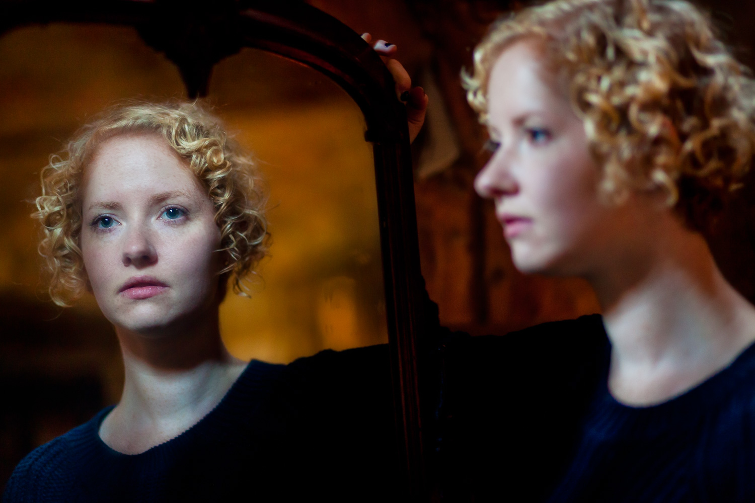 An image with an eerie painterly effect was achieved by photographing this young woman's reflection under a mixture of daylight and incandescent lighting.