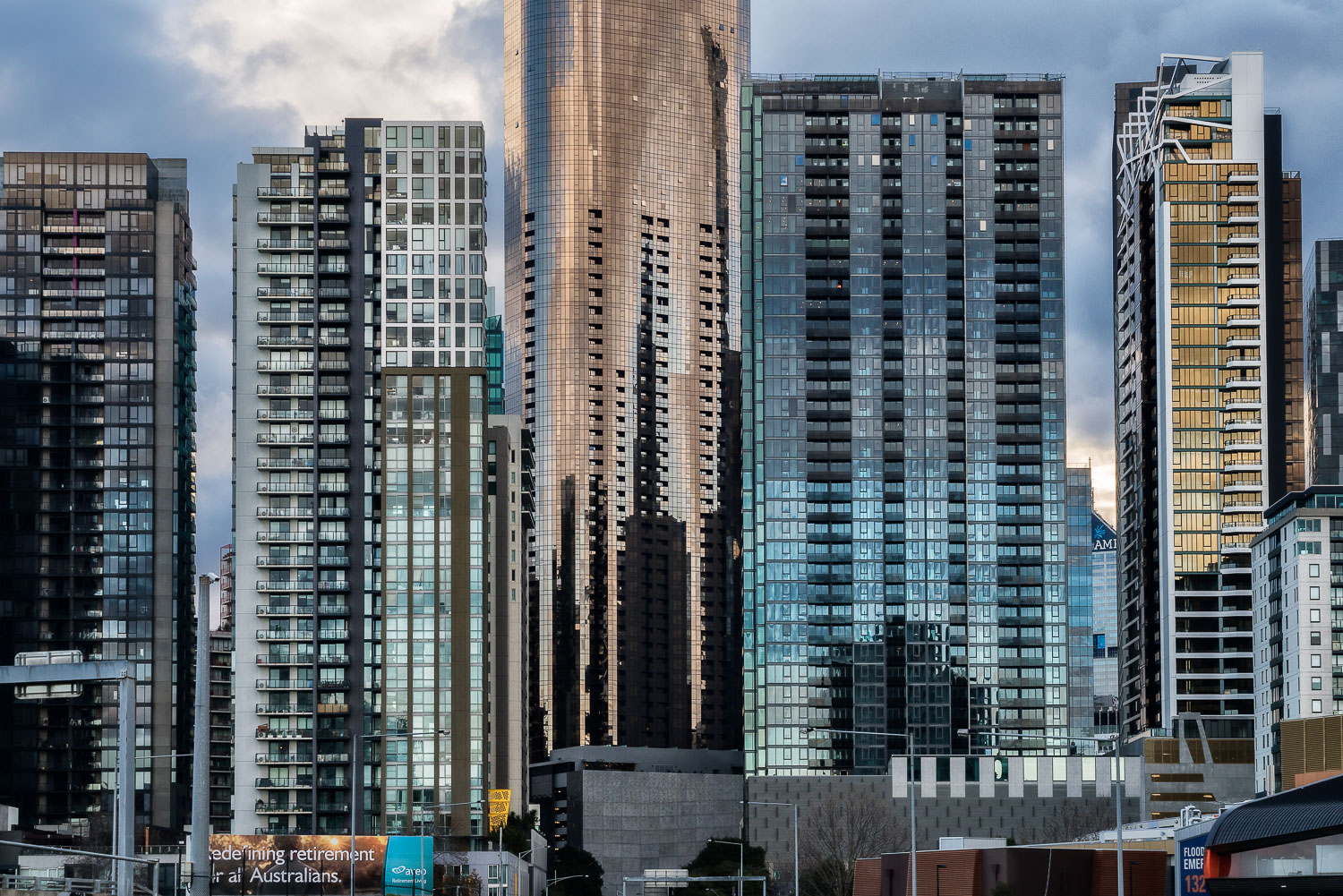 The glow of the    golden hour    illuminates these skyscrapers in    Lorimer Street    on the edge of the    Docklands precinct, Melbourne   .