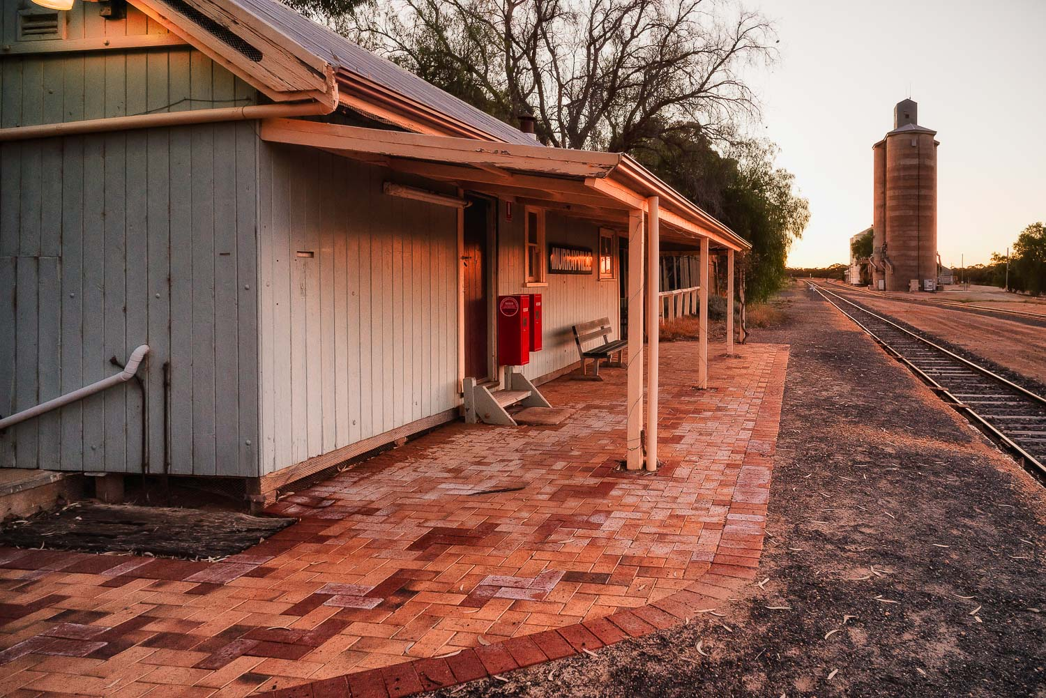 Sunset casting a soft, warm light on the now abandoned  Murrayville Railway Station  in the  Sunraysia  region of  Australia .