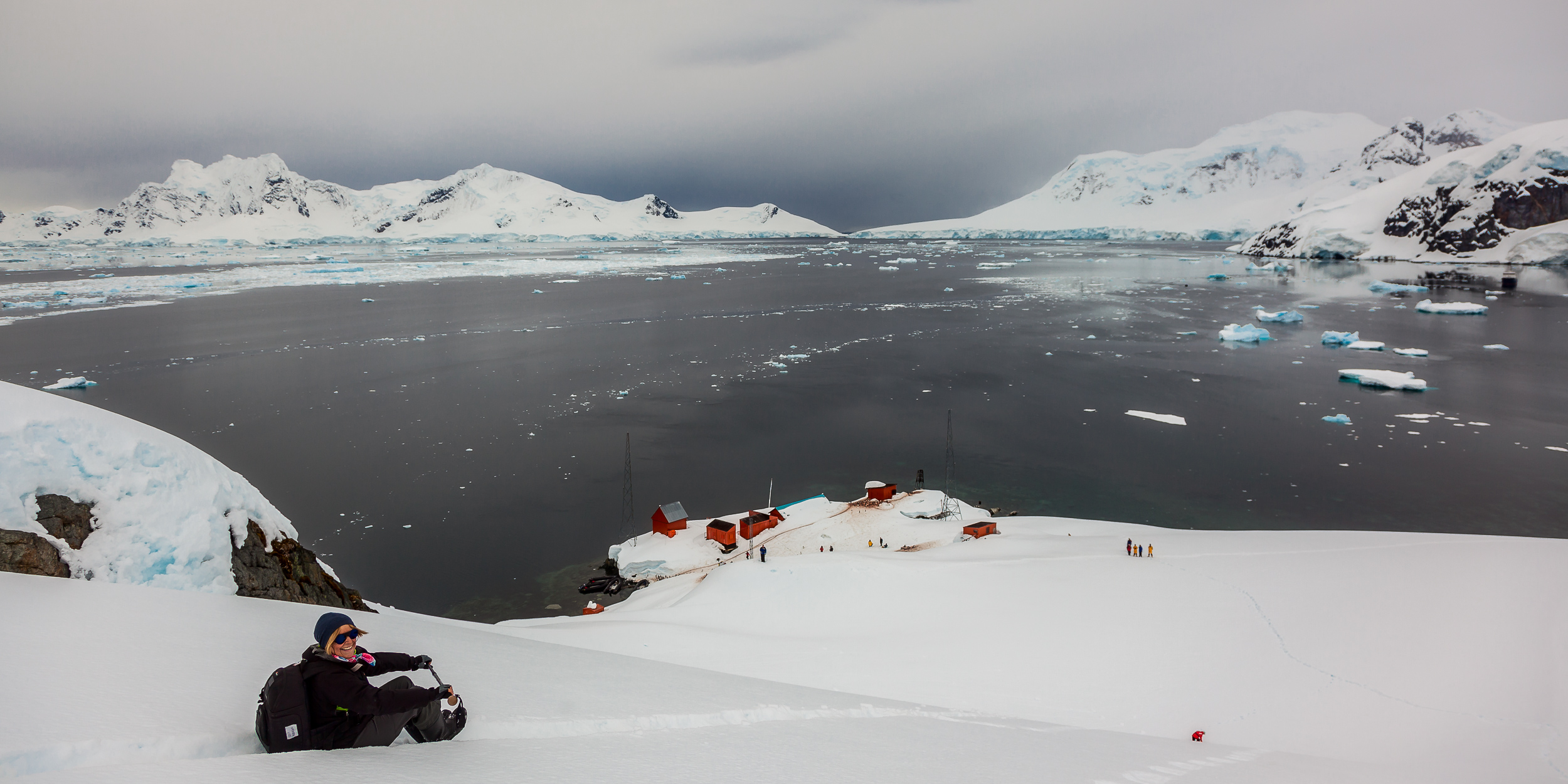 It's a thrill sliding down the hill overlooking    Paradise Harbour    in    Antarctica   .