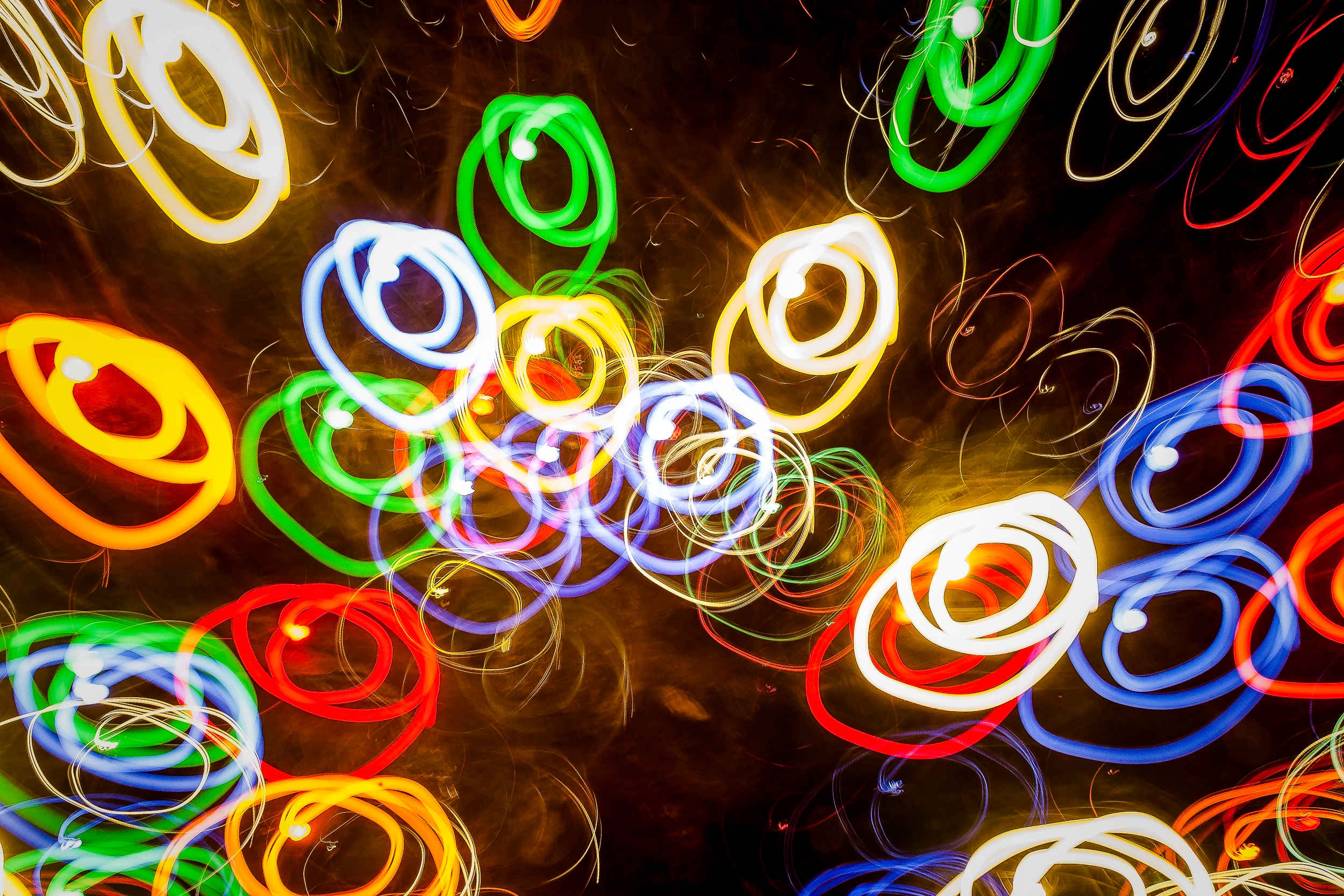 An abstract image of    circles of light    made by moving the camera, in a circular pattern, through a    10 second exposure   .