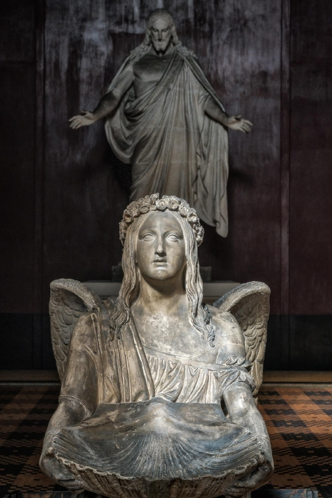 Angel and christ statues    at    Thorvaldsens Museum    in    Copenhagen, Denmark   .