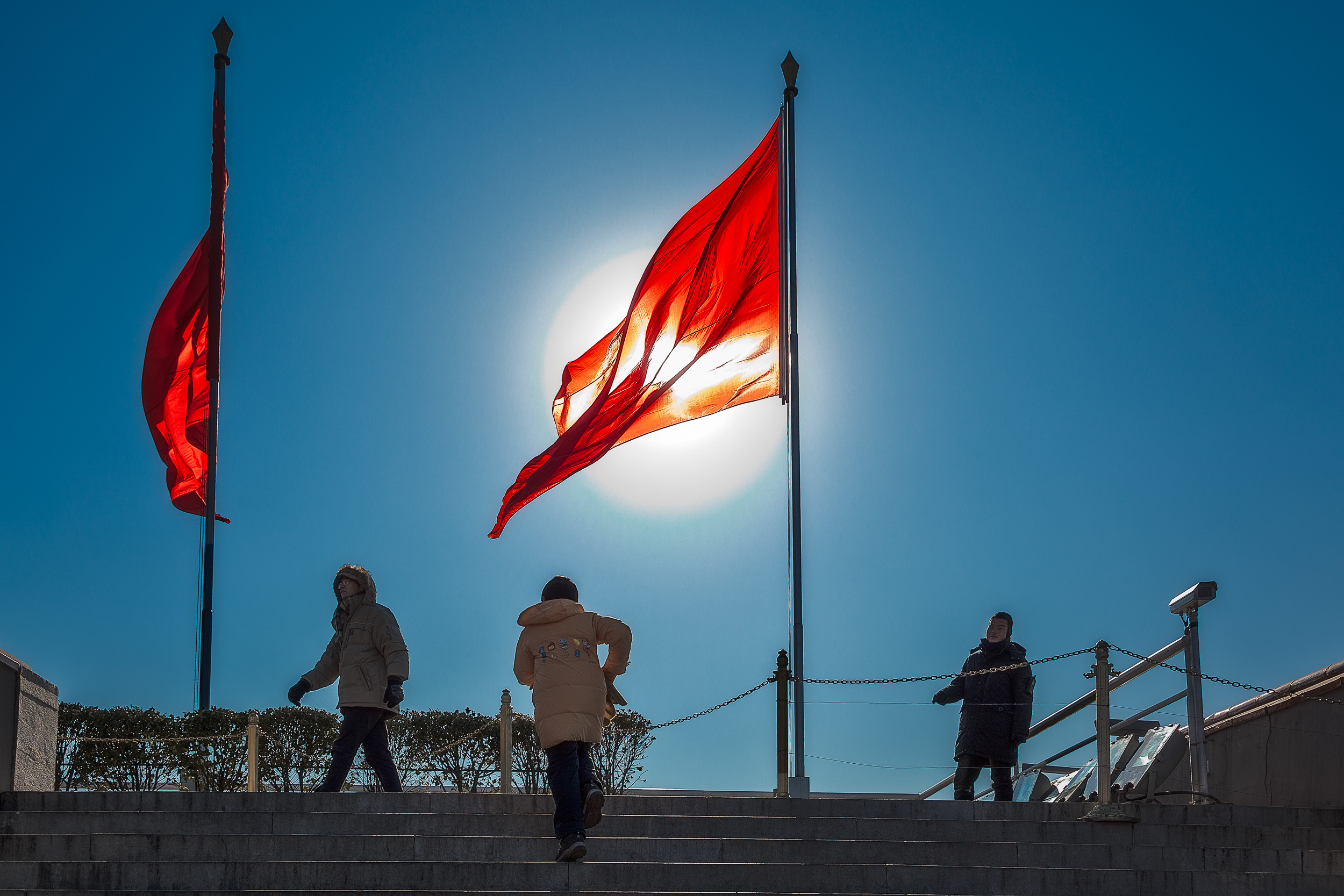 The red    communist China flag    flies, above    Tiananmen Square   , from the ramparts of the    Forbidden City in Beijing, China   .
