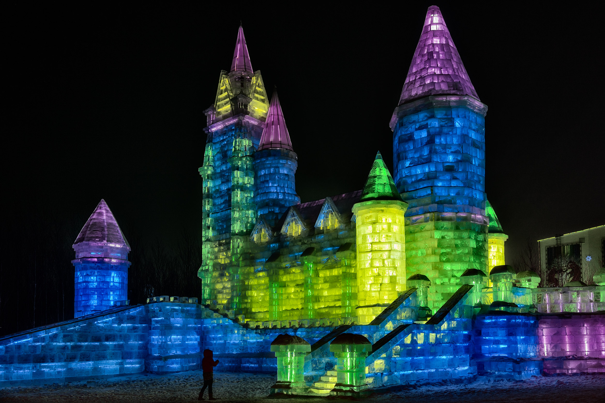 A magical and somewhat kitsch    castle   , made of ice and illuminated at night, at    IceWorld    in    Harbin, China   .