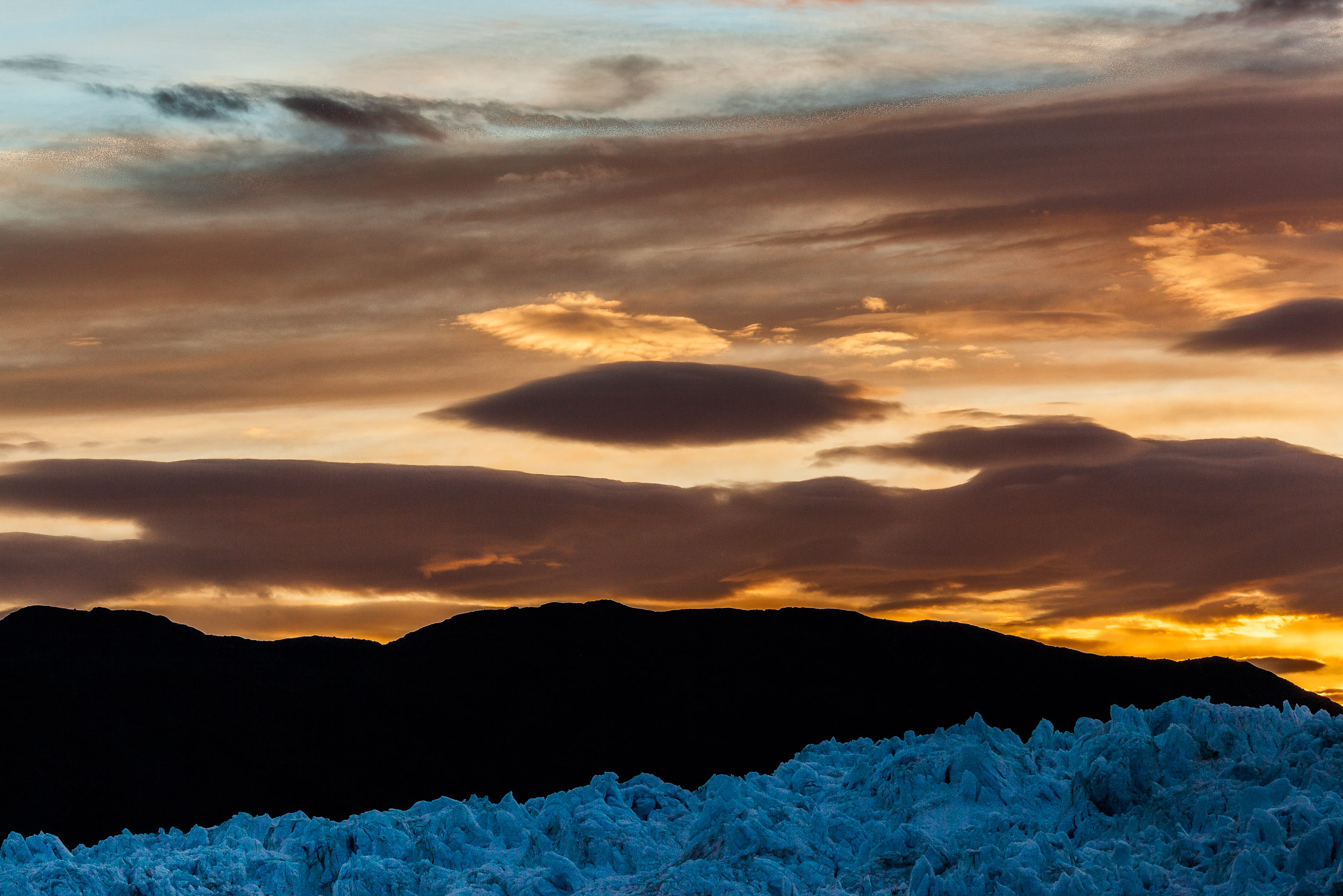 Looking over the    Eqi Glacier    towards a    spectacular sunset, Greenland   .
