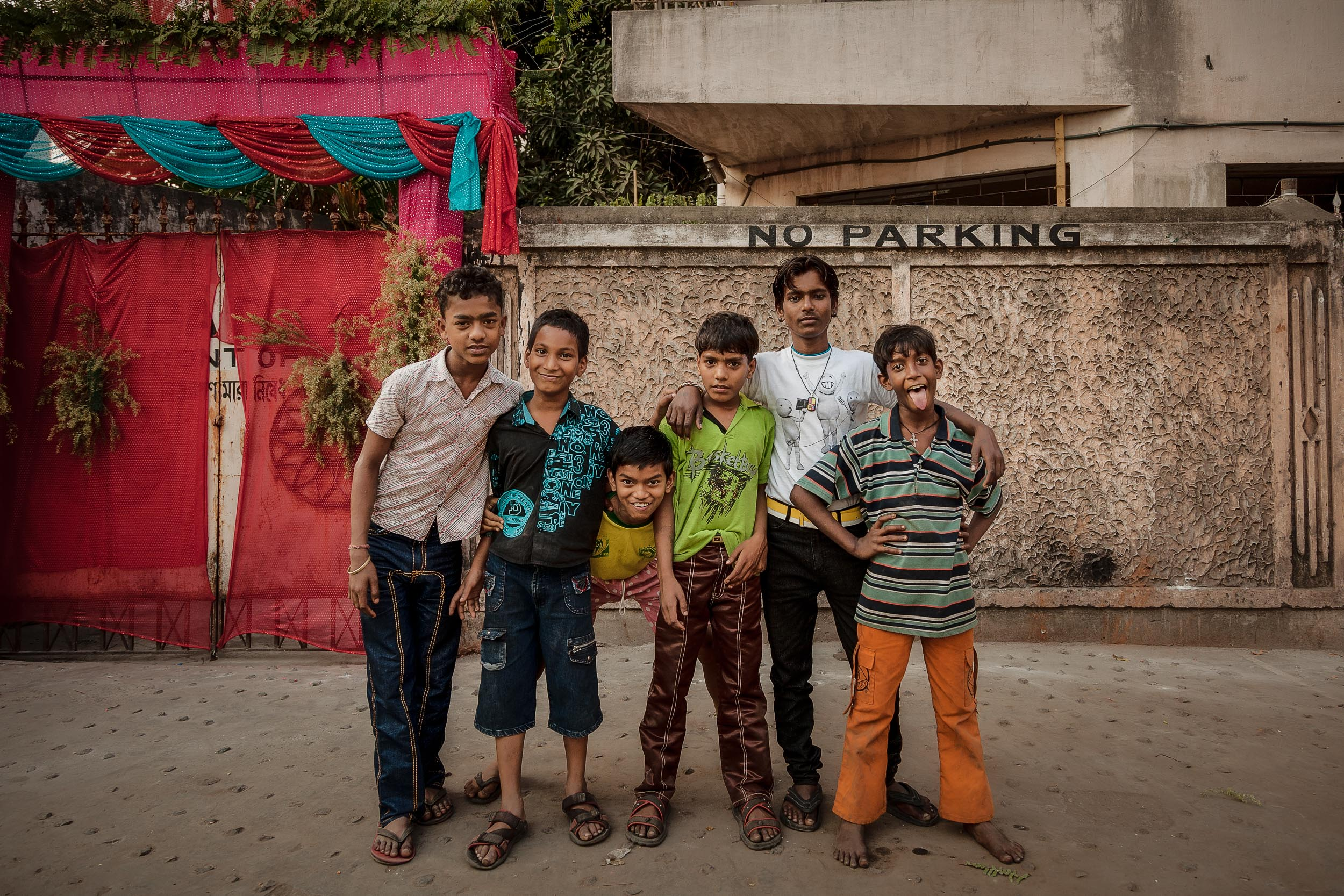 A group of    young lads    pose for a photo in the streets of    Kolkata, India   .