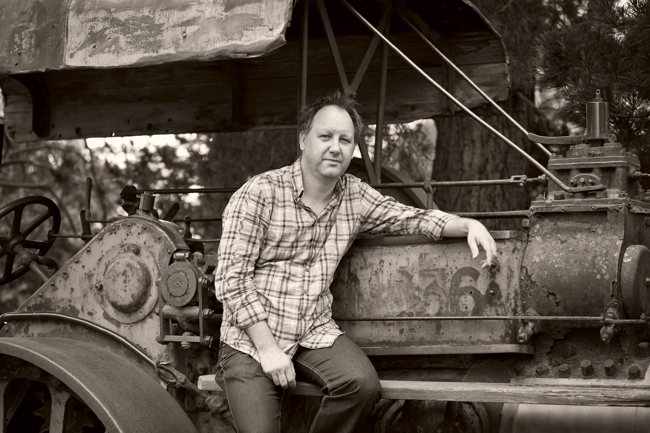 A  sepia like portrait  of Dale, seated on old machinery, on the outskirts of  Melbourne, Australia .