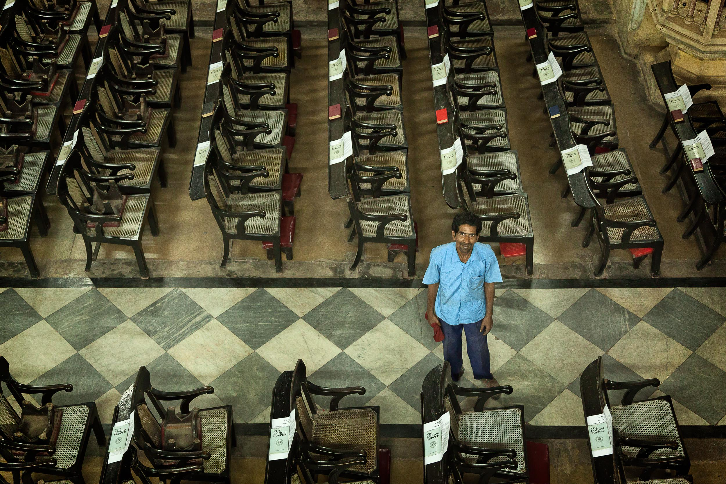 An  attendant  cleans the interior of a  church  in  Kolkata, India