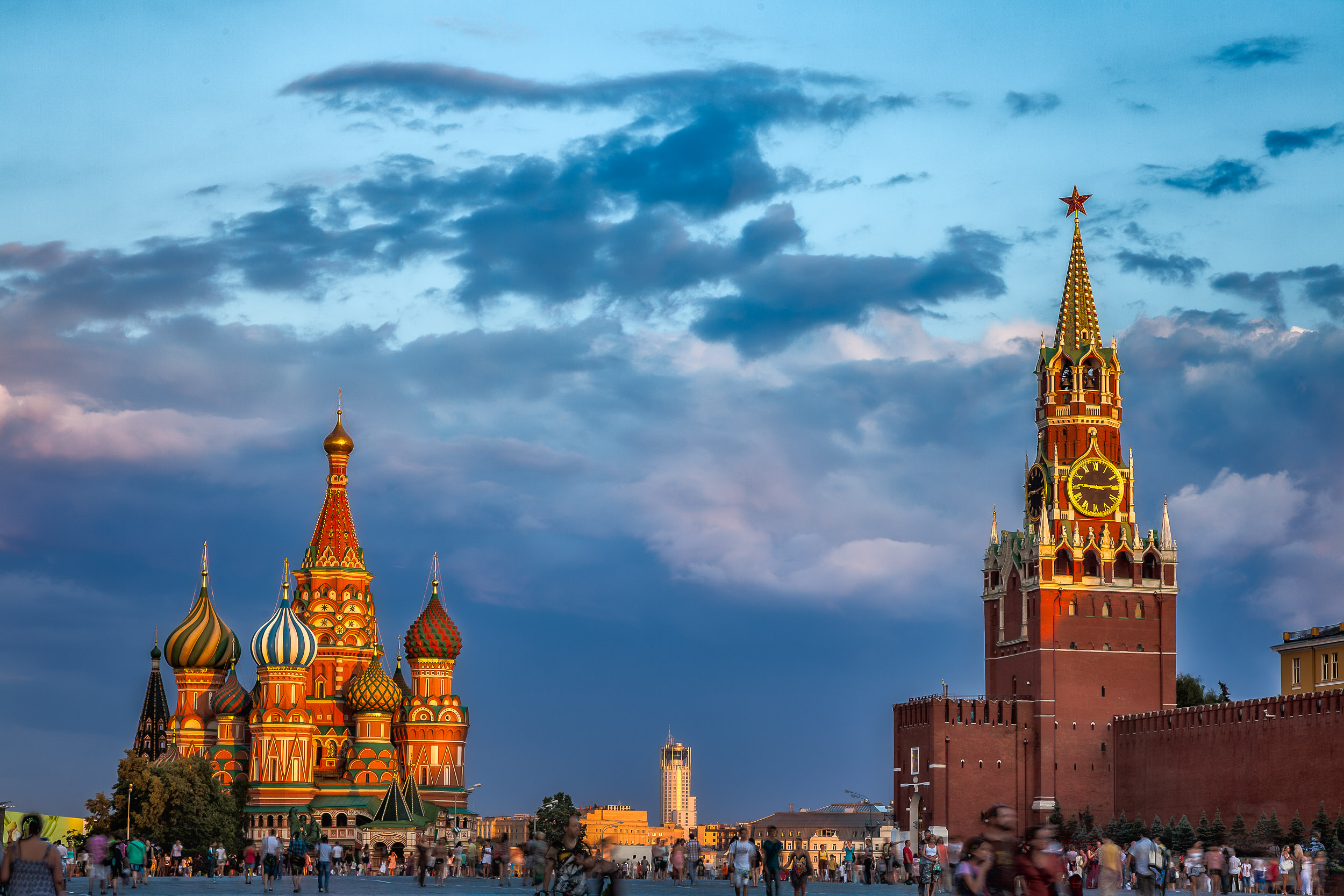 Warm    sunset light    illuminates the    Kremlin    and    St. Basil's Cathedral    in    Red Square, Moscow   .