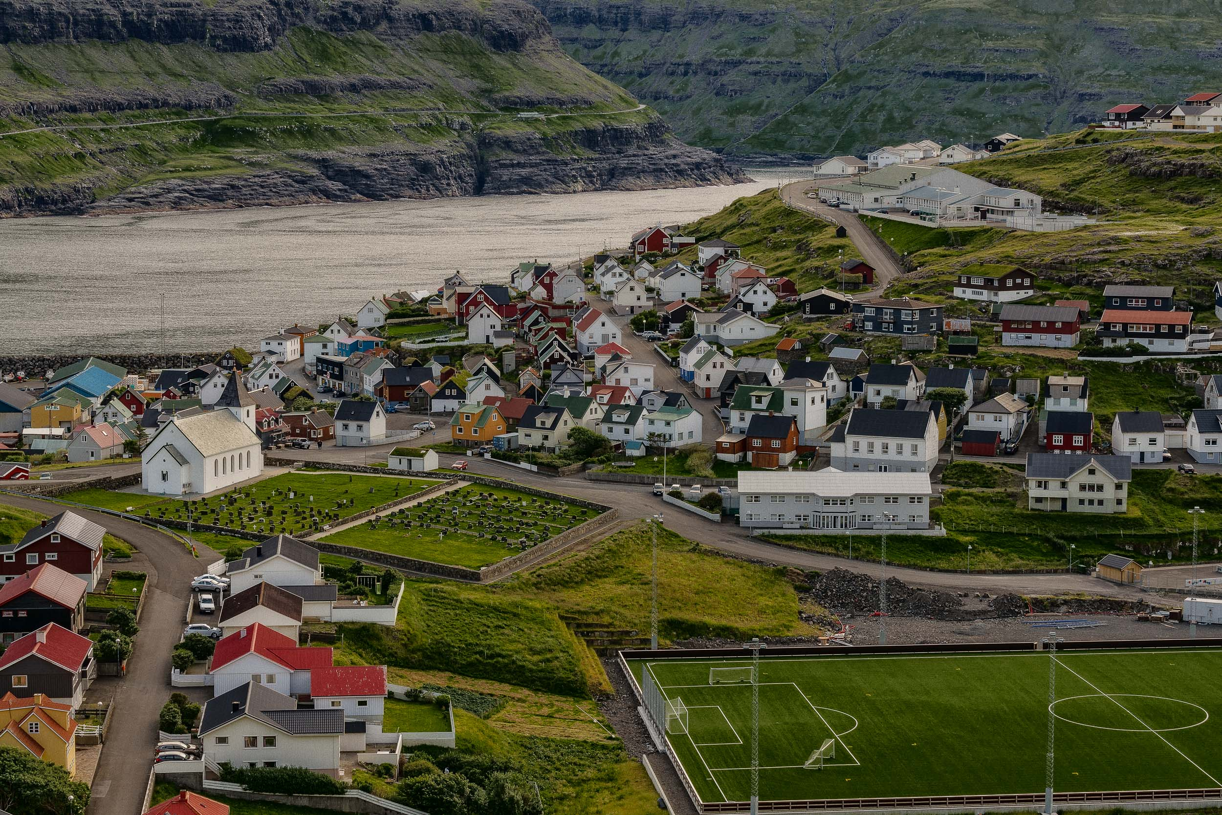 Looking down onto the    picturesque village of Eidi at dusk    on the island of    Eysturoy    in the    Faroe Islands   .
