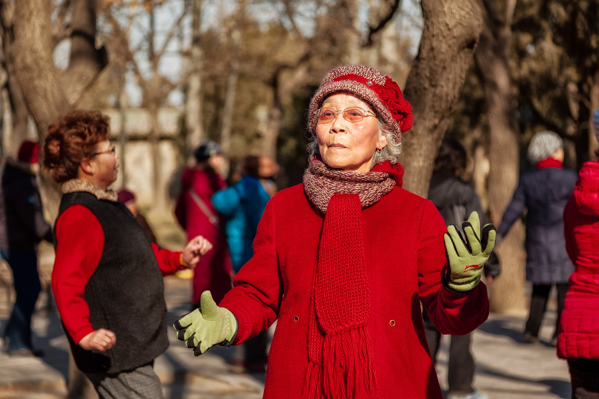A group of    elderly women dancing    in the grounds of the    Temple Of Heaven   , on a winter's day, in    Beijing, China   .