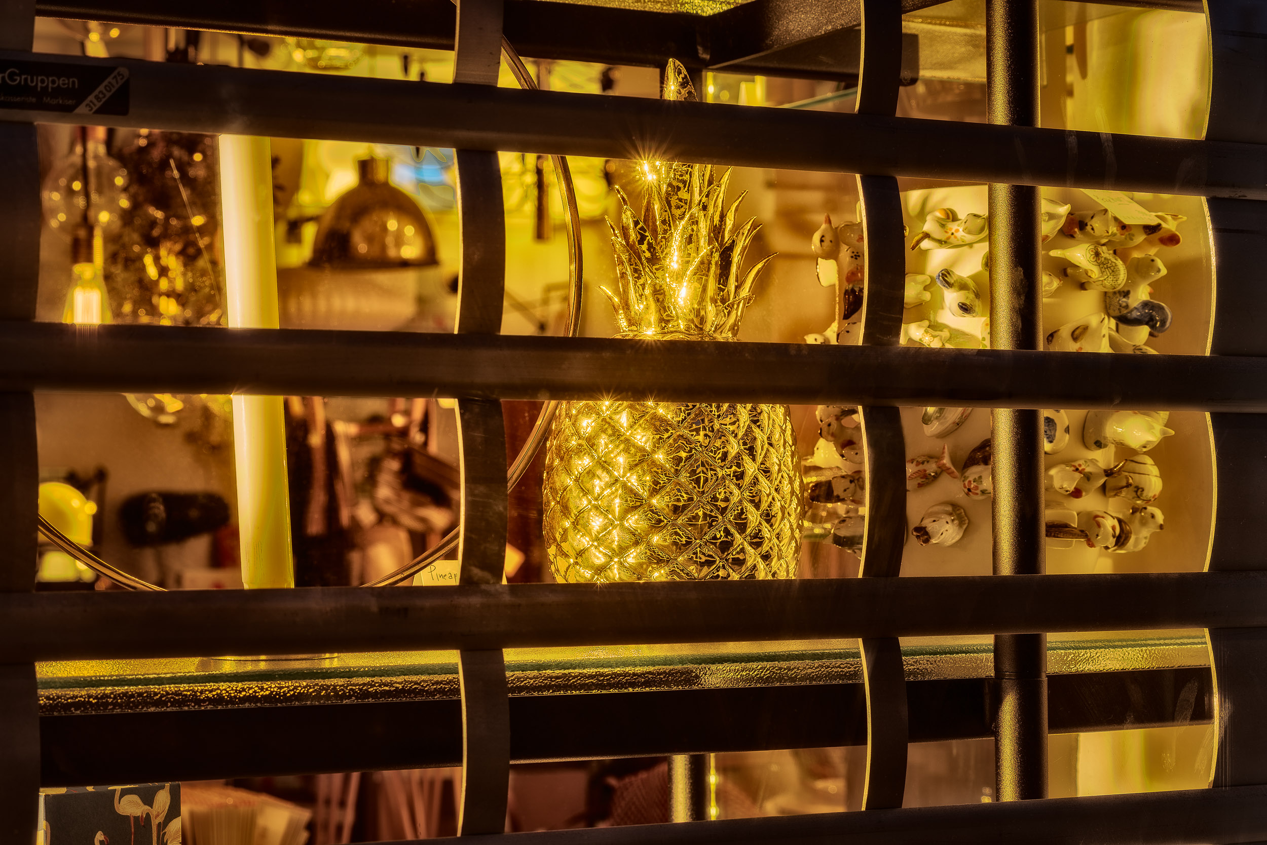 Night time is the right time for  atmospheric still lifes , such as this  golden image  photographed through a shop window in  Copenhagen, Denmark .