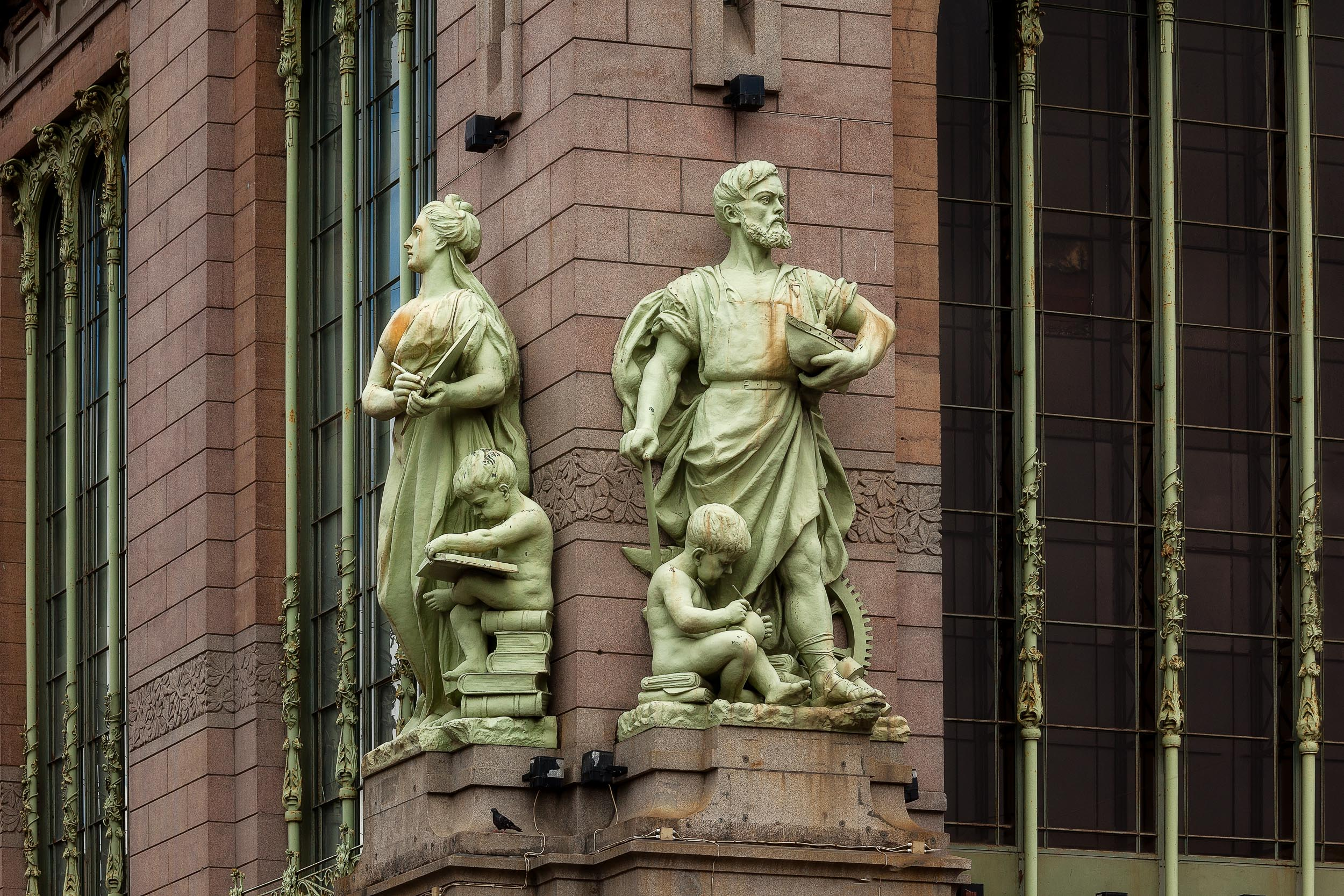 Statues  signifying strength and learning on an  historic building facade  above the  Neva River  in  St. Petersburg, Russia .