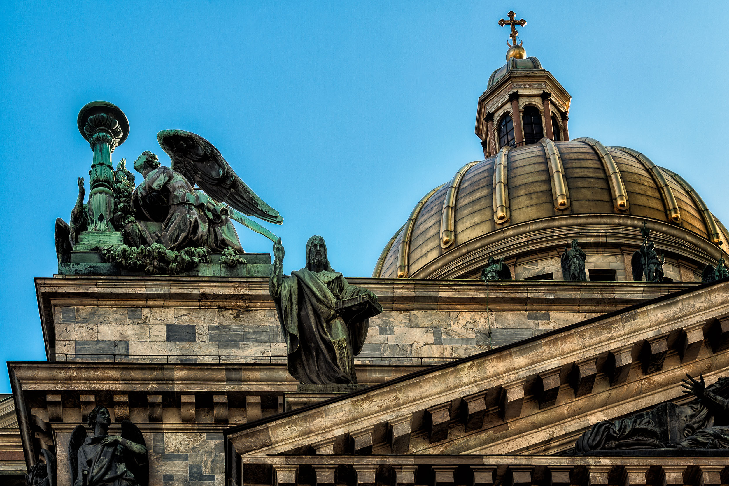 A dramatic view of the  dome and statues  at  St. Isaac's Cathedral ,  St. Petersburg, Russia .