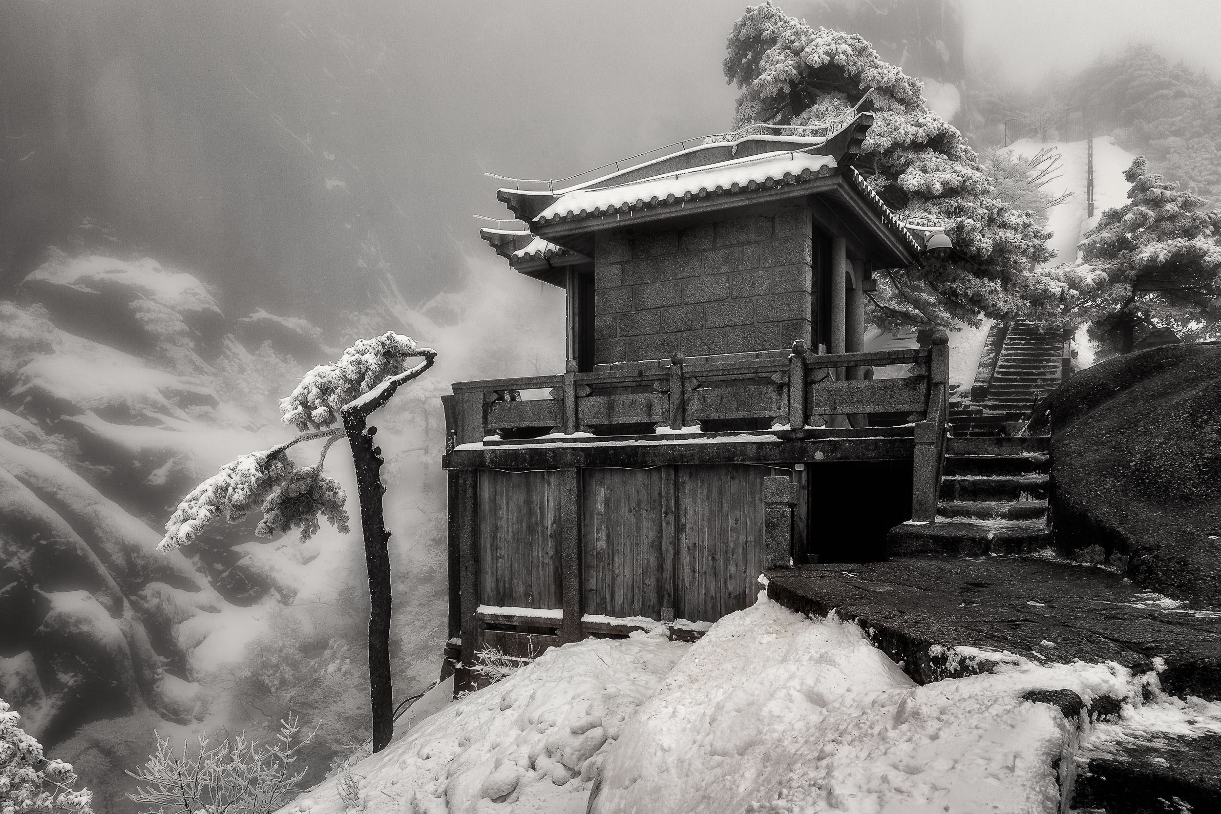 A  rest stop for travelers  near the top of a  high, windswept pass  on  Huangshan  (i.e., Yellow Mountain) in  China .