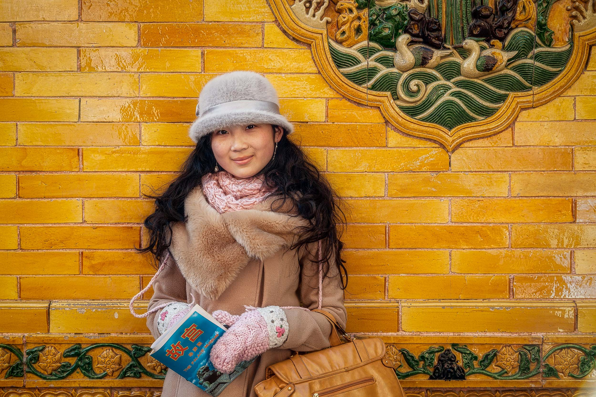 A  portrait  of a  beautiful young woman  in the  Forbidden City  in  Beijing, China .