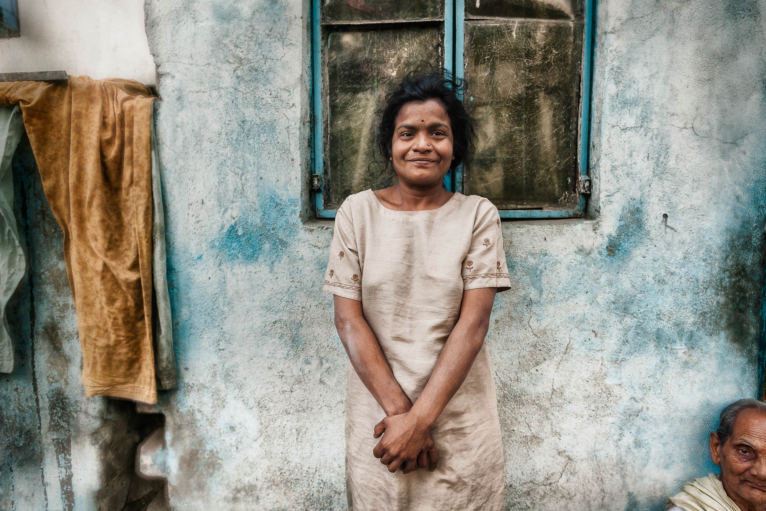 A    portrait of a woman    in front of a    colorful background    in    Kolkata, India   .
