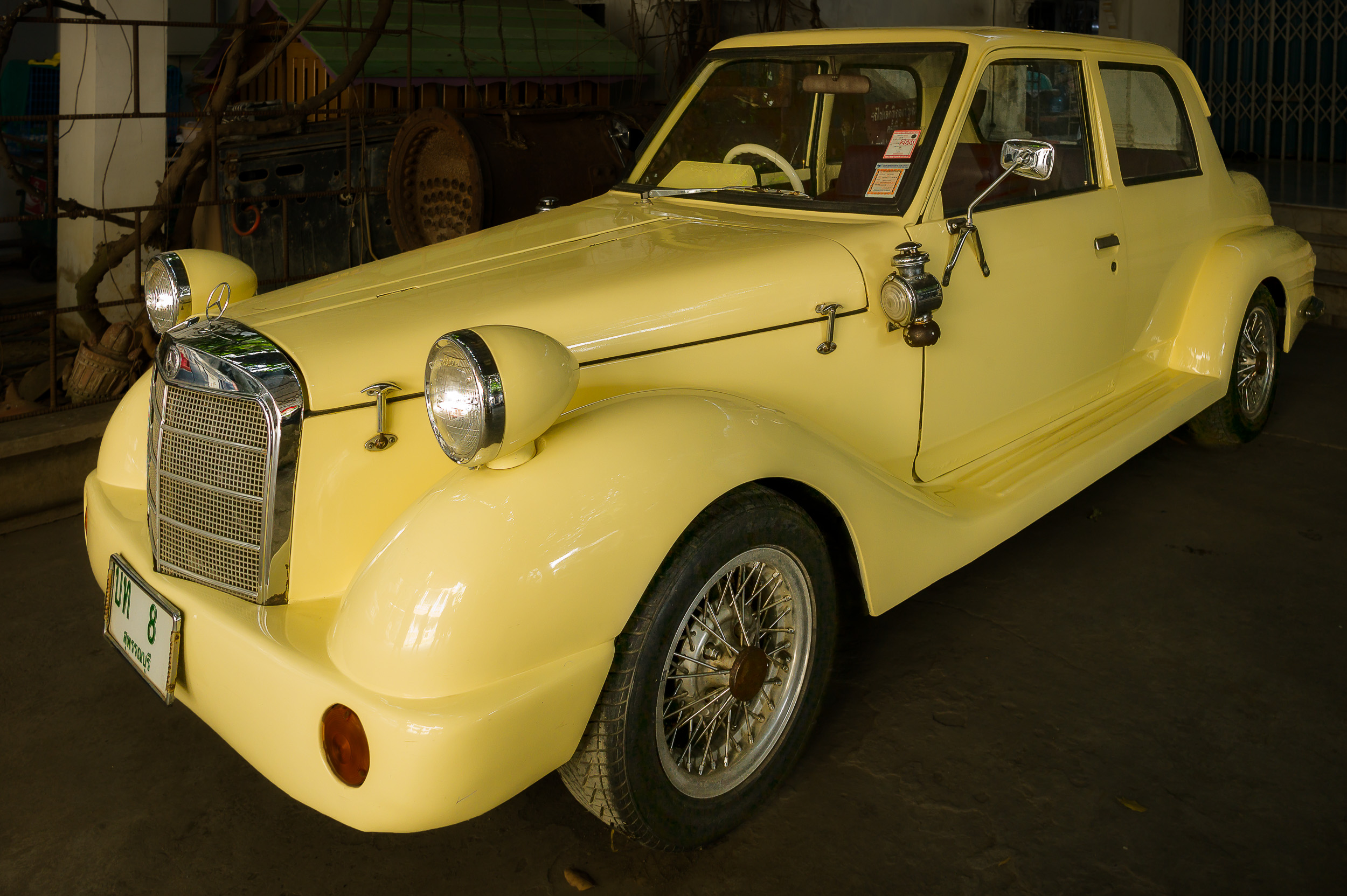 A beautifully restored  mercedes benz  in the  museum  alongside the  Bridge On The River Kwai  near  Kanchanaburi  in  Thailand .