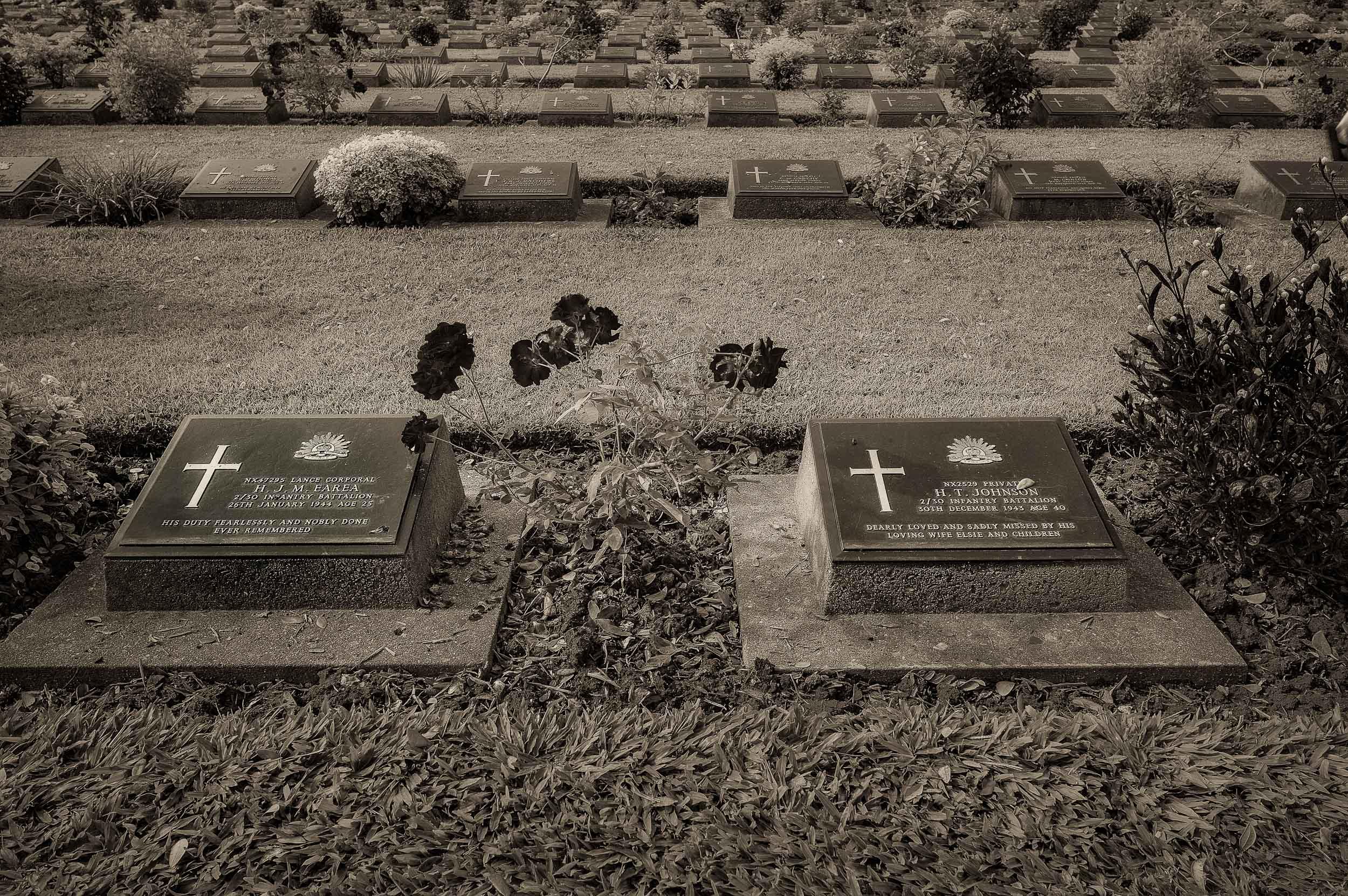Grave stones  at the beautifully maintained  Kanchanaburi War Cemetery  in the town of Kanchanaburi,  Thailand .