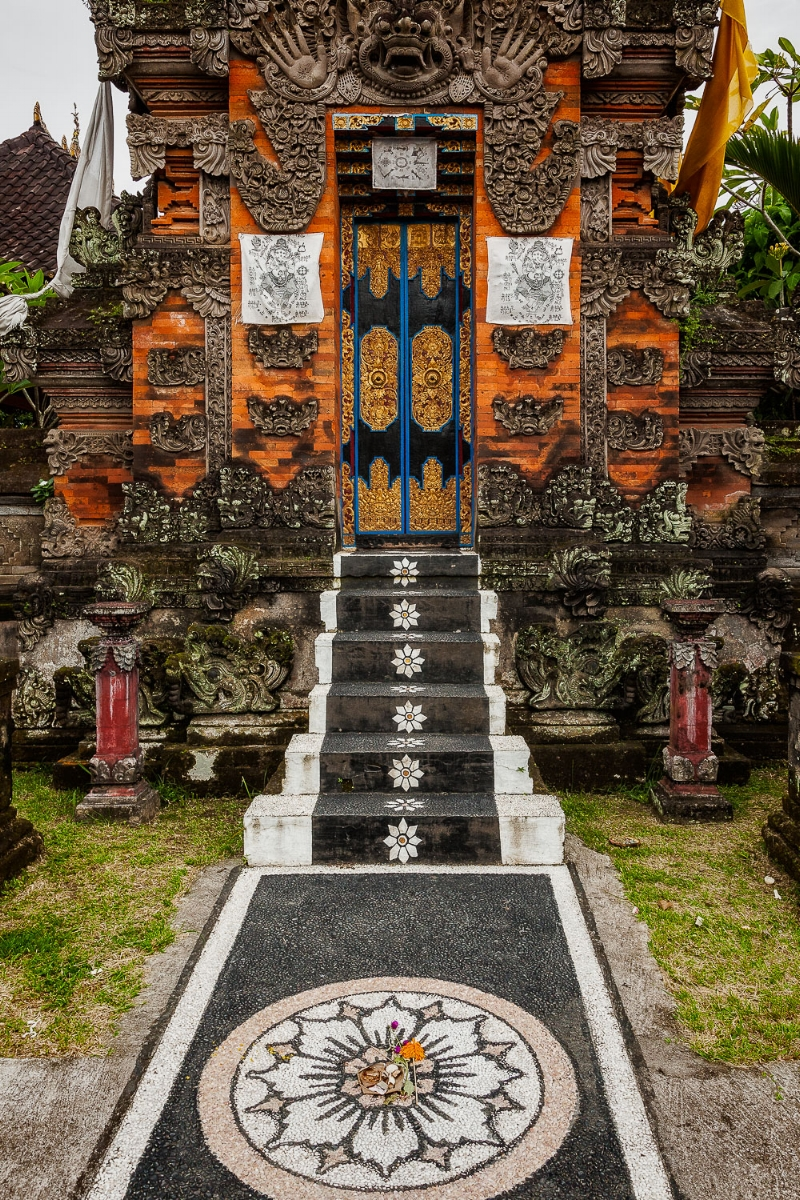An  ornately decorated pathway  leads to a beautiful entrance to a  Hindu Shrine  in  Bali, Indonesia .