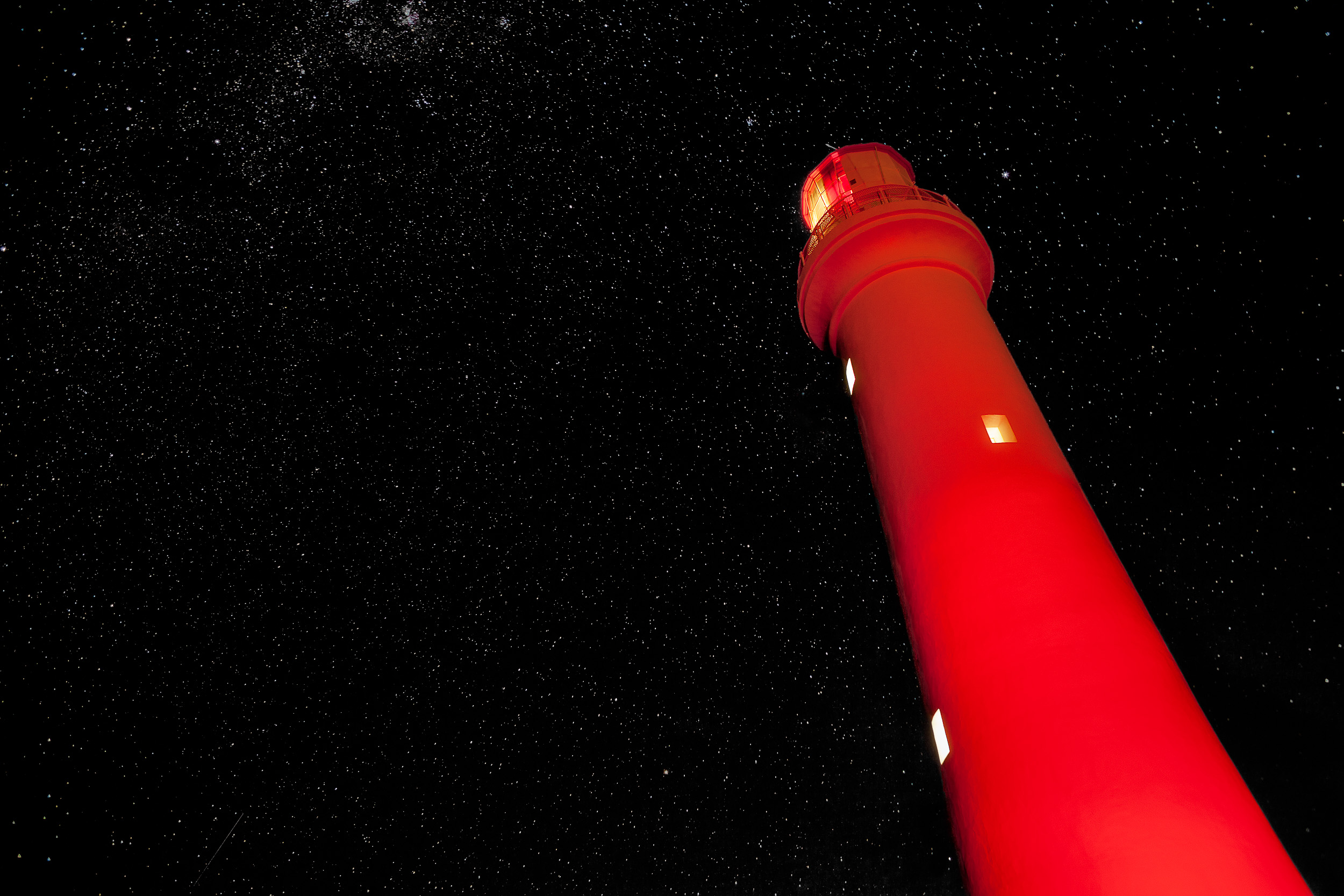 Red light illuminates the    Split Point Lighthouse    at    Aireys Inlet    along the    Great Ocean Road    in    Australia   .