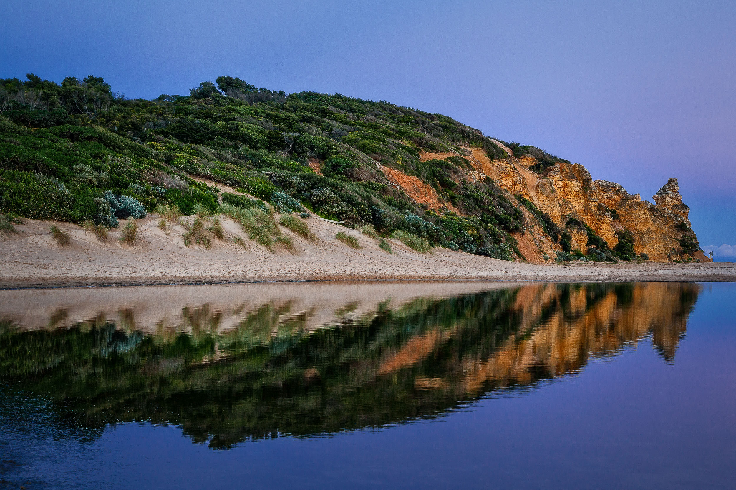 A beautiful reflection on    Painkalac Creek, Aireys Inlet   , at dusk along Victoria's    Great Ocean Road    in Australia.