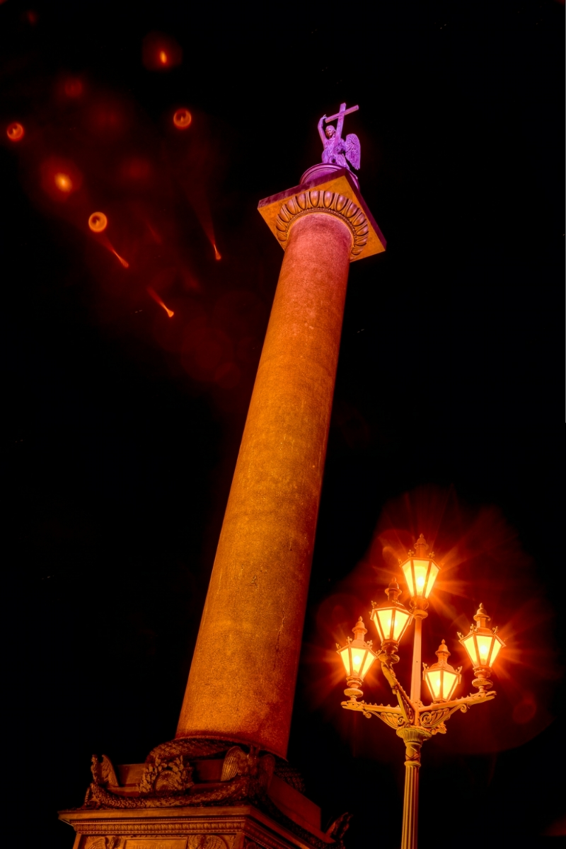 The spectacular    Alexander Column   , illuminated at night, at    Palace Square    in    St. Petersburg, Russia.