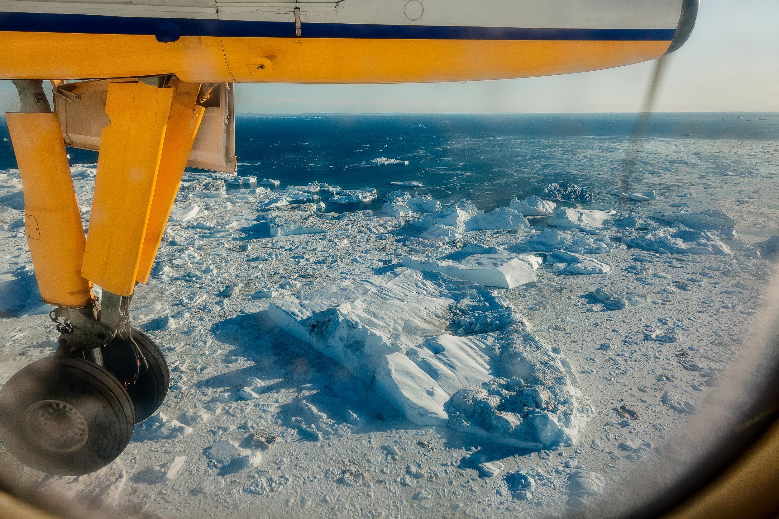 A view over the  Ilulissat Icefjord  from my seat, as the  aeroplane's landing gear comes down , prior to landing near the town of  Ilulissat  on the west coast of  Greenland .