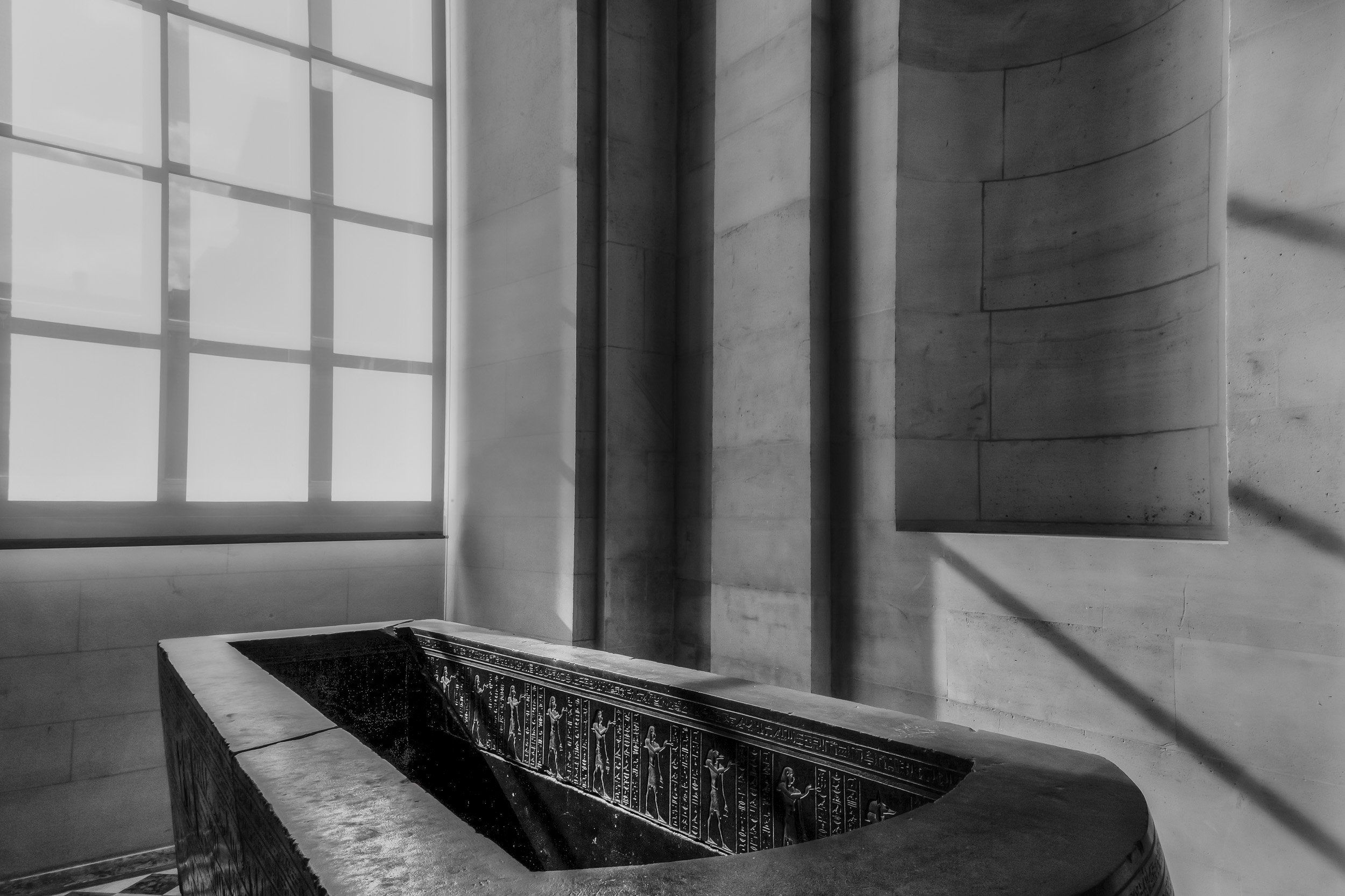 Dynamic shapes and shadows providing the perfect setting for this  Egyptian Sarcophagus  within the  Louvre  in  Paris, France